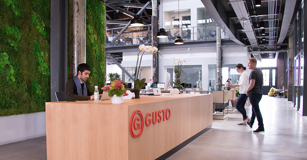We partnered with a Gusto customer, Planted Design, to create a stunning moss wall behind reception. It's a perfect contrast to the industrial interior.