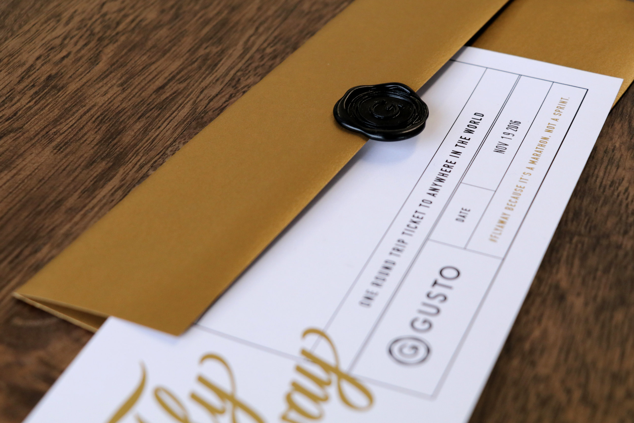Each ticket comes in a gold envelope with a Gusto branded wax seal.