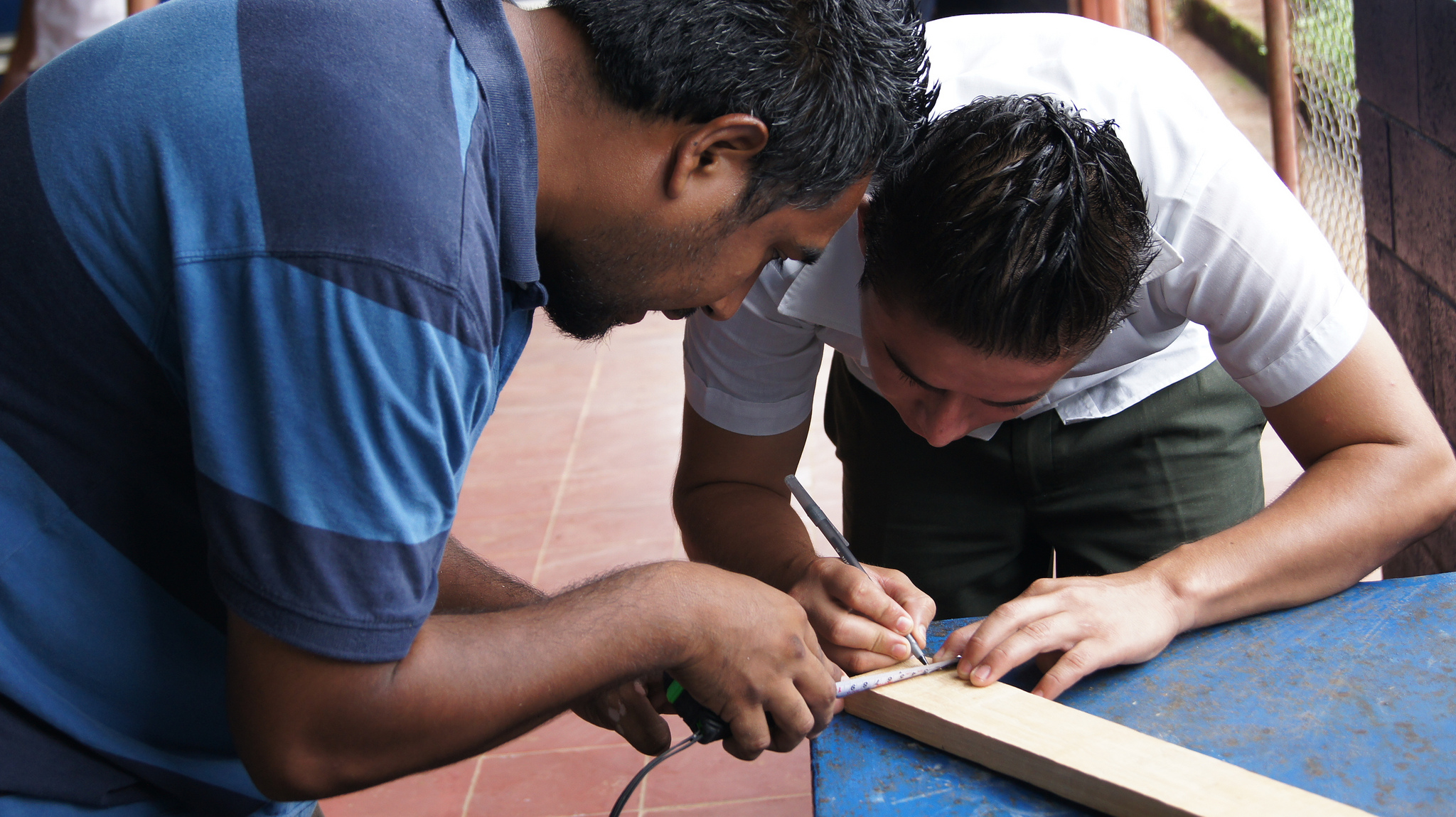 Rafael Reyes helped students create their own fret boards out of wood and simple materials so that they could practice at home.