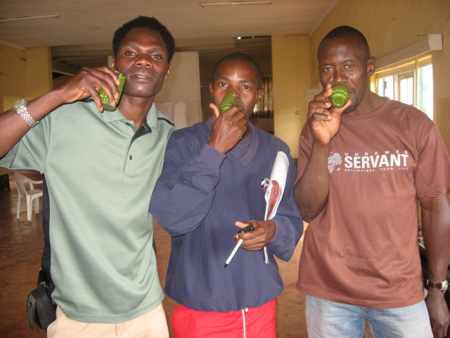 Rueben Ndwiga, of Kenya, Francis Lubega and Peter Kimbugwe, of Uganda, enjoy a freshly made smoothie after receiving a lesson on how to store and preserve food in times of scarcity.
