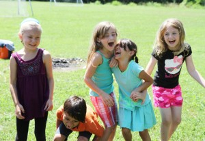 Moriah Olson, Justice Garner, Kiah Roufs, Luci Munoz and Esther Bargatze laugh hysterically during a drama lesson at Camp Kaibigan.