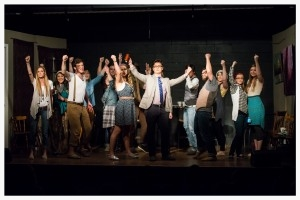 """The cast of """"It's Elementary,"""" concludes one of their musical numbers."""