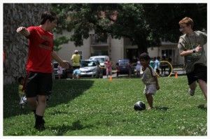 At this low-income apartment complex, students facilitate soccer drills and hula hoop contests for their new friends.