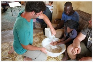 Summer intern Gerard had numerous opportunities to serve during the time they spent in Uganda. Here they help prepare for the meal by washing hands.