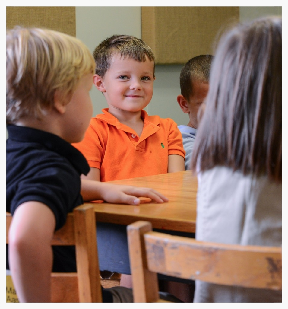 Students in the Kindergarten class are excited to come to school each day. Samuel Johnson smiles amongst classmates at G.O.D. Elementary.