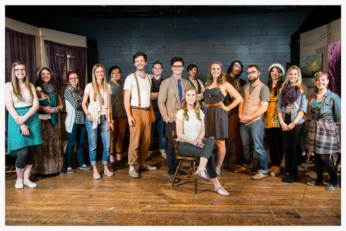 """It's Elementary Group Photo: Part of using drama and theatre effectively is to address cultural norms and assumptions, provoking re-evaluation and dialogue. The actors of """"It's Elementary"""", pictured above, caricatured modern day stereotypes in the portrayal of their characters. A musical, """"It's Elementary"""" was the grand finale of the Arts at Center Street's first Night of One Acts. Producer of the Night of One Acts and writer of this article, Sara Davis, is seated center."""