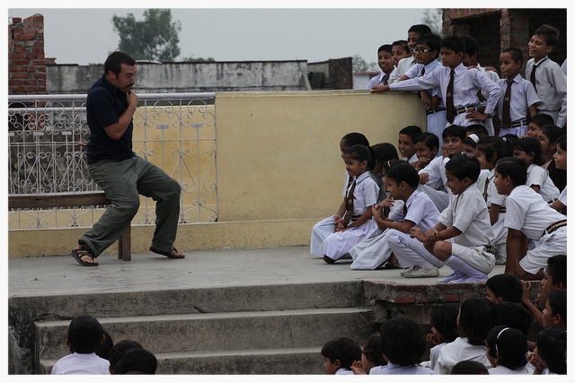 Dramatic expression can transcend language barriers and communicate biblical truths. Here Corey Streeter, also a participant of the 2010 SLAM Da' Mission to India, participates in a skit at a school in rural India. This particular skit emphasizes the importance of helping one's neighbor in need. Drama is a very necessary tool in communicating messages to illiterate audiences.