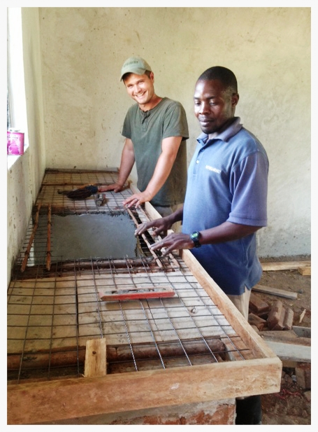 Cameron Kagay and Francis Lubega created a form for concrete countertops in the triplex. Cameron is skilled in plumbing and trim work, Francis in masonry.Together, the two not only utilized skills already attained, but explored new ones as well.