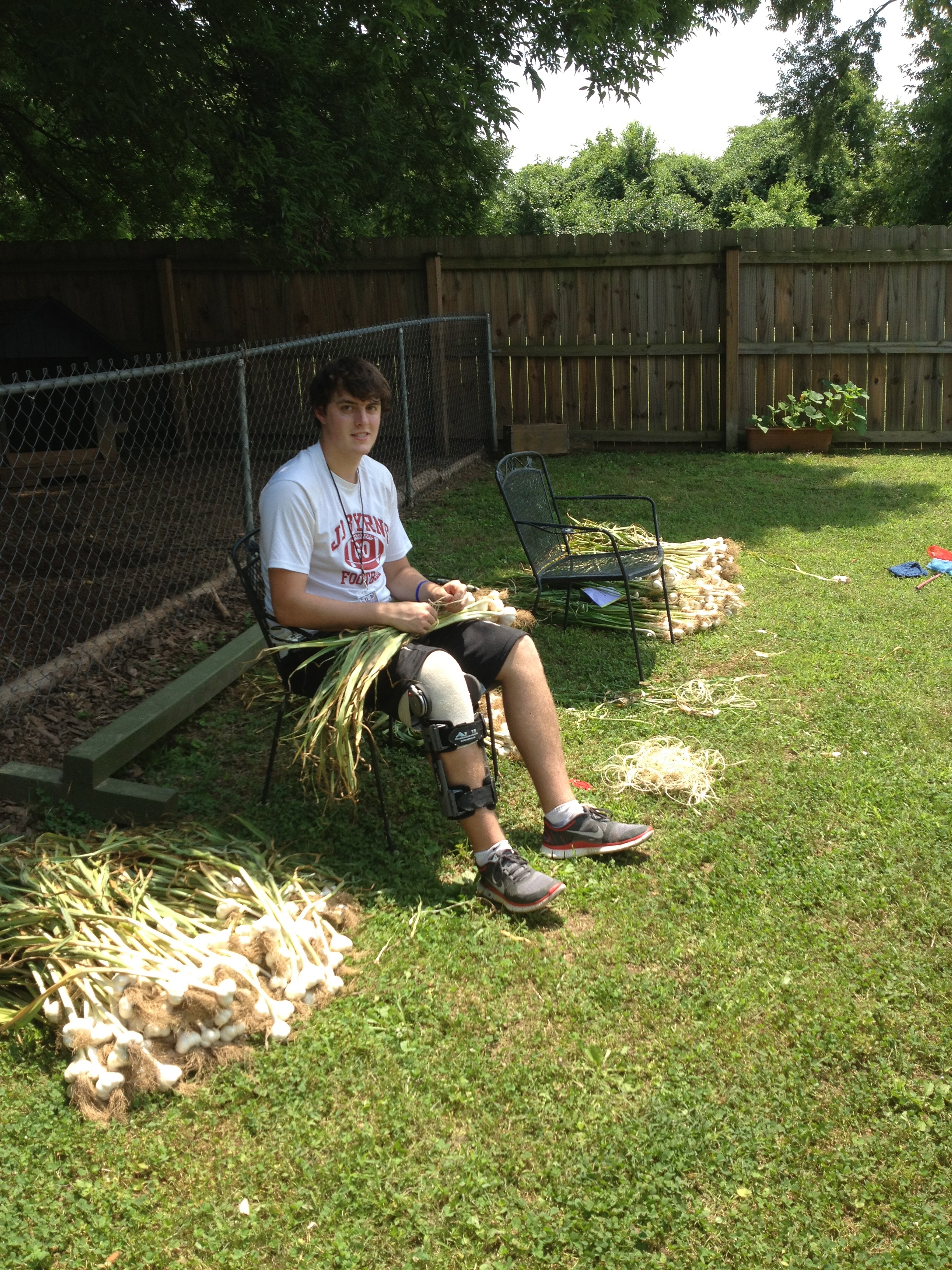 Though Levi couldn't dig in the garden with his peers due to a football injury, he and Seth shared good conversation about the way Jesus reached out to those who found themselves marginalized as a result of injury or sickness.