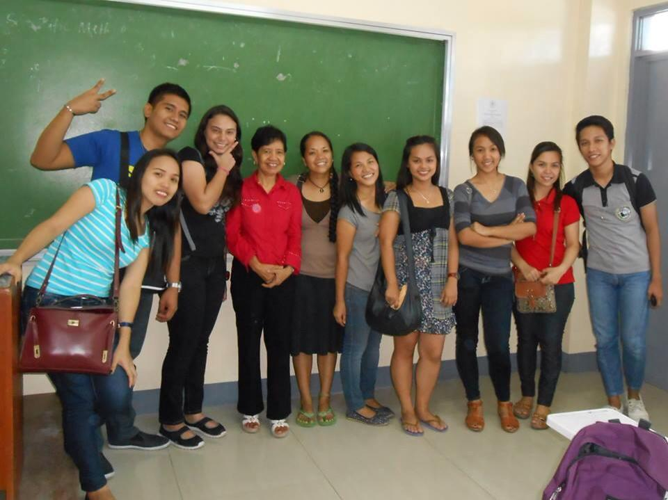 Rina and her classmates from Columban College celebrate after 4 years of hard work towards their Social Work degree.