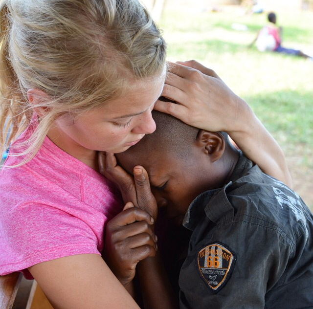 Laura Foster, one of Miller's teammates, held Apollo while he suffered the pains of a headache from malaria. The loving touch is an important and essential part of treatment. Humanizing care and compassion is often missing in efforts to bring healing. People are not problems to be solved, but persons to be served.