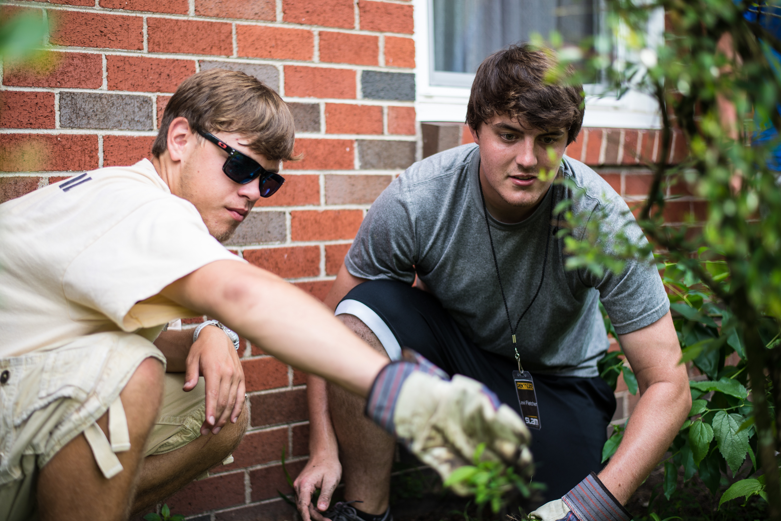 Young people not only spend time in a community garden, but also weeding and planting in the yards of elderly and widowed individuals. They learn the practicality of food production, alongside the simple pleasure brought to a grandmother when she receives flowers in place of weeds.