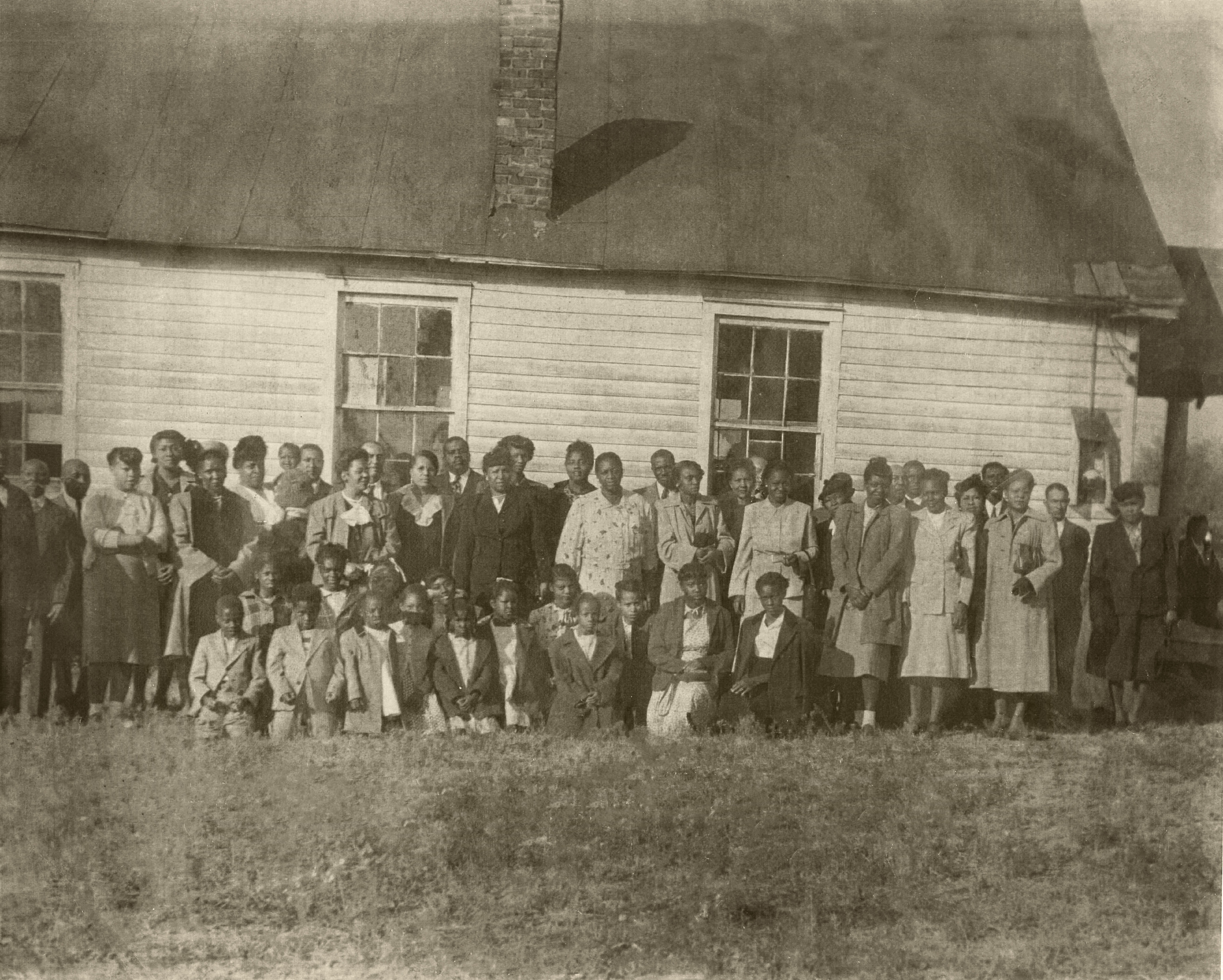 Circa 1930 - Hopewell residents standing outside 1st Baptist Church of Hopewell. Although many of the Hopewell families represented in this picture have moved out of the 'old neighborhood,' there are still children and grandchildren of some of the original Hopewell families living in the neighborhood. It is those children, now elderly, that we are privileged to serve.