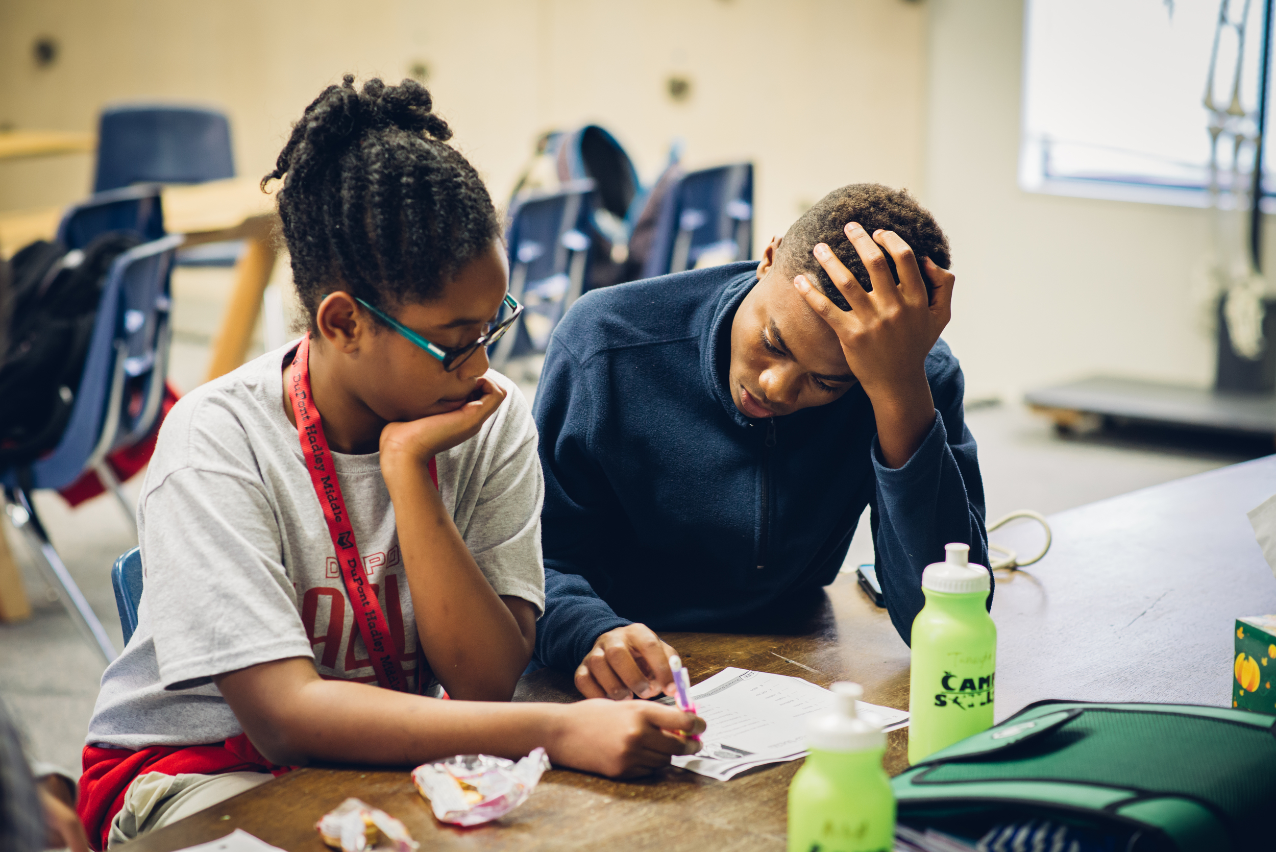 High school student, Gerron, helps Tanayia, 11, with her math homework. Gerron lives in the neighborhood and participated in Camp Skillz last summer. After learning about CASE, he asked if he could volunteer twice a week as a tutor.