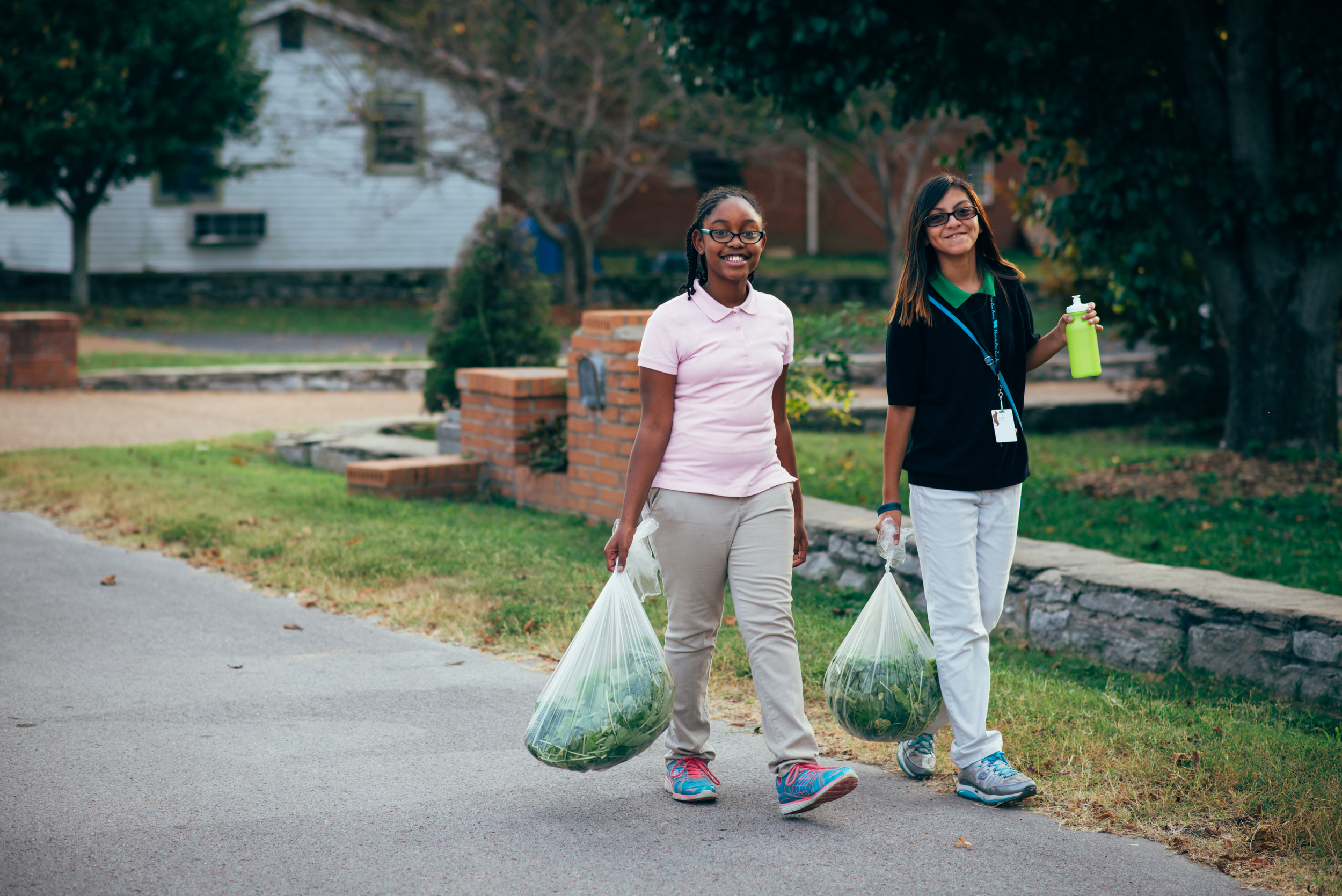 Tanayia and Arlette deliver vegetables freshly harvested from Hopewell Gardens to widows within the Hopewell neighborhood. These two girls developed a wonderful friendship over the course of the semester.