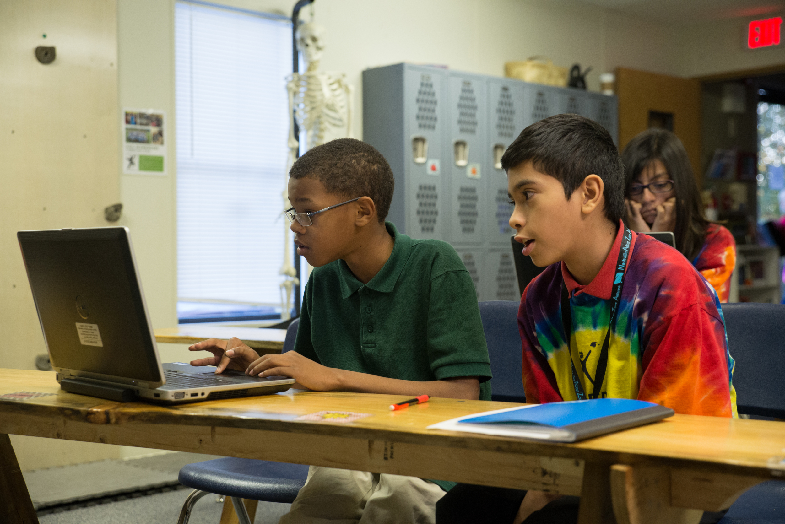 Sean and Francisco, deemed CASE's resident computer experts, troubleshoot problems during a computer programming activity. Technology has increasingly become part of school curriculums, as schools recognize the importance of computer literacy in the 21st century.