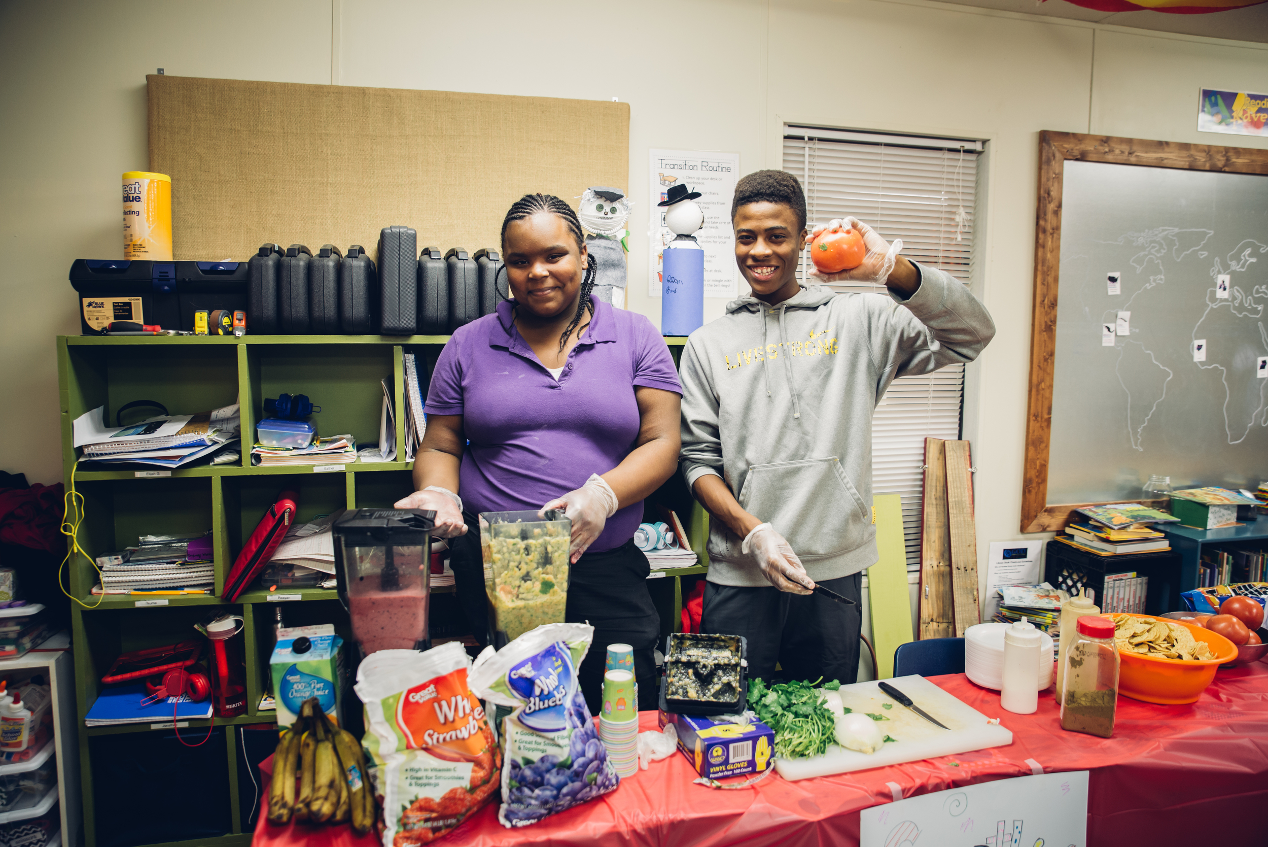 "Yasmin and Gerron proudly display their homemade smoothies and salsa which they served their families and friends who came to ""ShowCASE."""