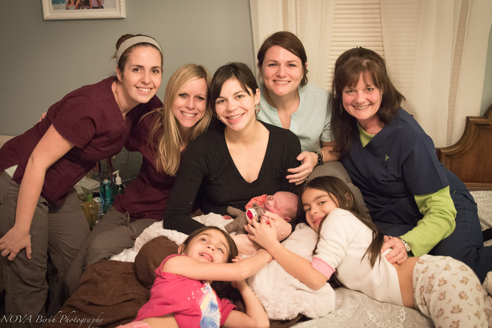 This was yet another special birth! Heather Munoz, CPM (center), was surrounded by best friends and birth workers as she gave birth to her fifth child.  From left to right: Celesta Bargatze, CPM, Tara Garner (doula, birth photographer), Elise Buckner (apprenticing midwife), and Mary Anne Richardson, CPM. All of the midwives in this photograph have been trained by Mary Anne Richardson. Thanks to her, we have been able to gain the necessary skills to attend women in birth.
