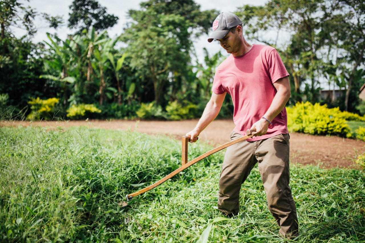 Cameron Kagay uses a scythe to clear our land that is rapidly growing during the rainy season. We introduced the scythe last summer, and they have been using it faithfully since.