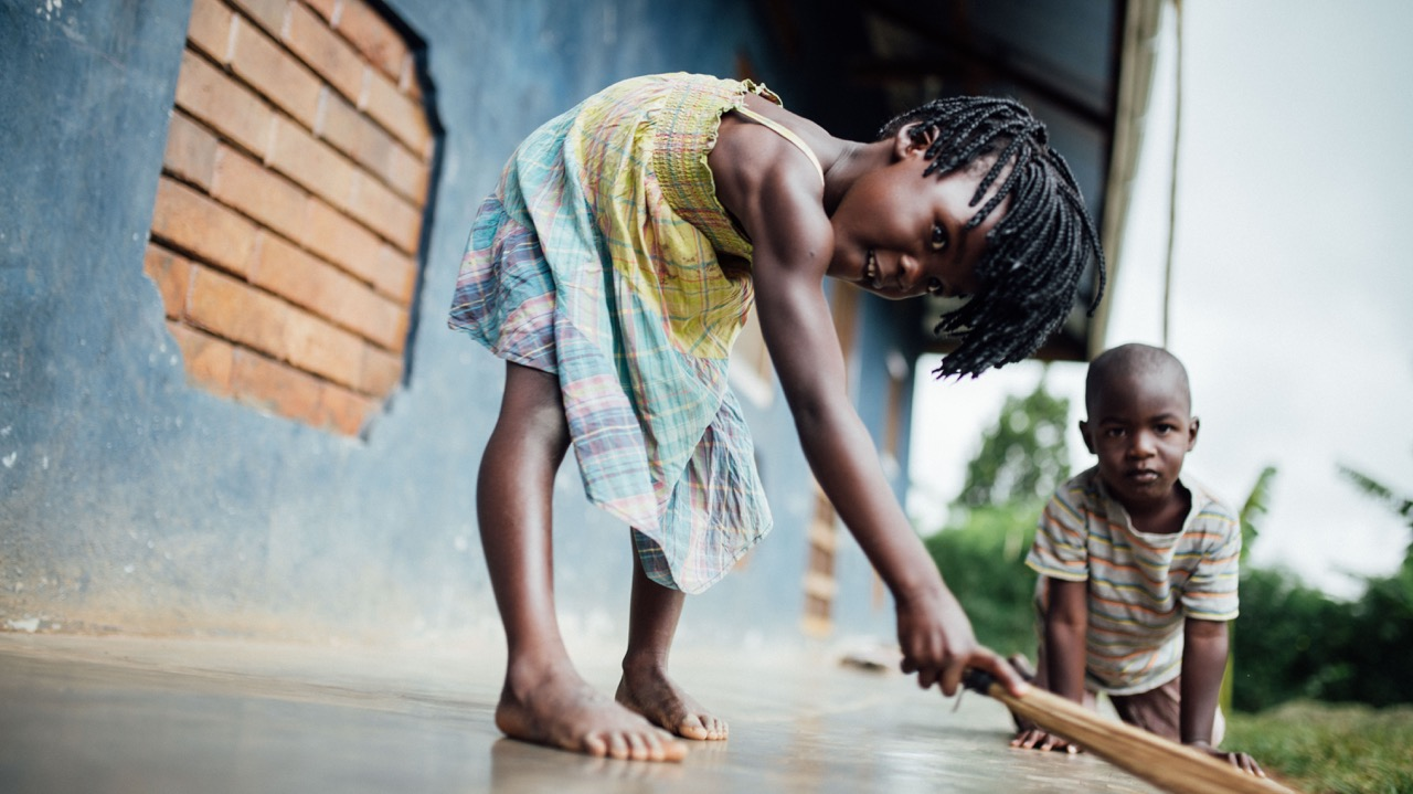 The children faithfully complete their own chores, like sweeping and gathering laundry.