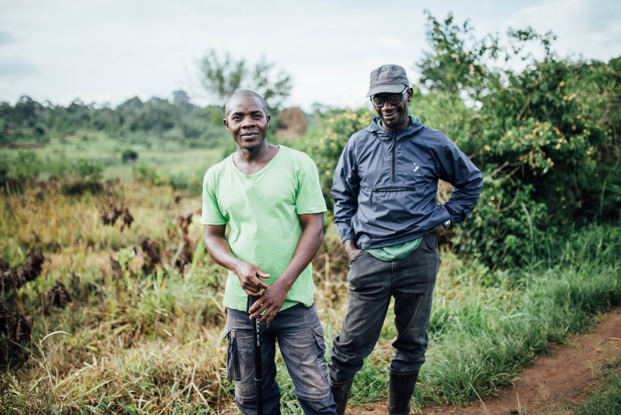 Francis Lubega and Peter Kimbugwe gave Aaron Montgomery, photographer, a tour of the local wells they had fixed.
