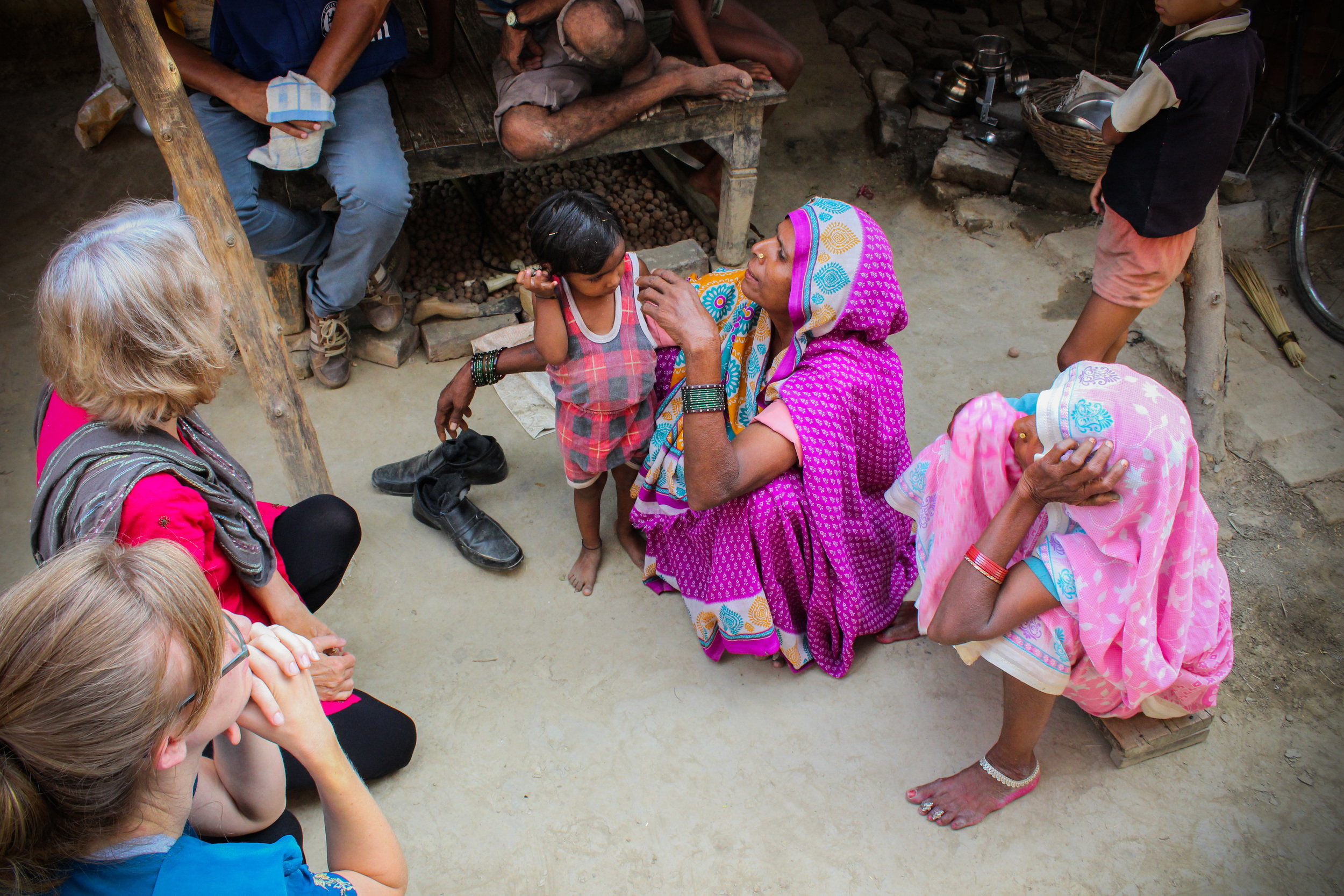 Santosh's mother-in-law (in purple) shares with Rosemary and Rachel her own story,later explaining that she has been sick with digestive issues and degenerative eye sight.