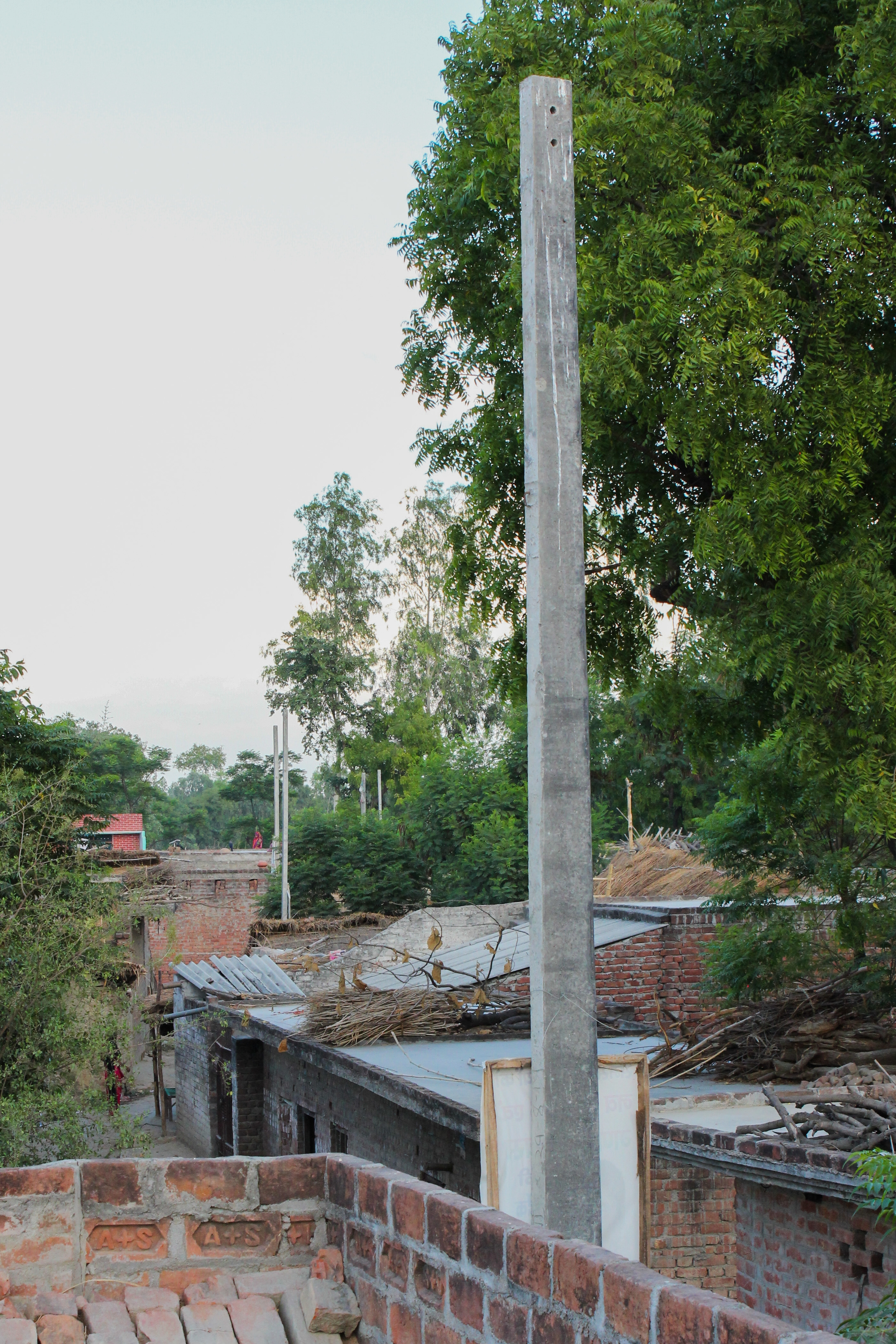 These concrete poles were set by the government to givelight service to the village. Theyhave no wires in them at all,and have been empty for over half a year, when theywereinstalled. This means that the faulty solar panels are the only source of electricity for thisvillage.