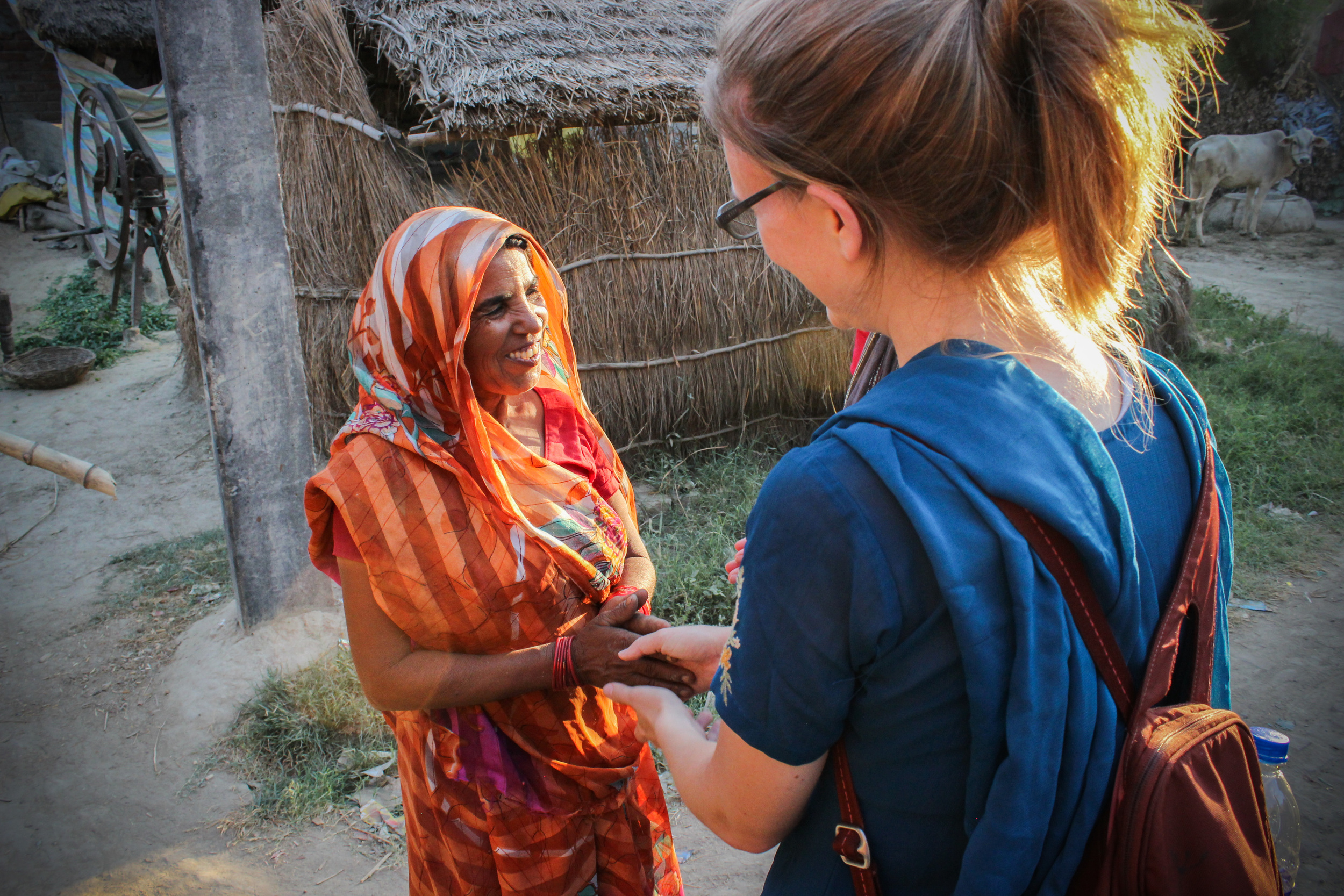 Rachel says goodbye to Santosh's mother, thanking them for their time and hospitality.