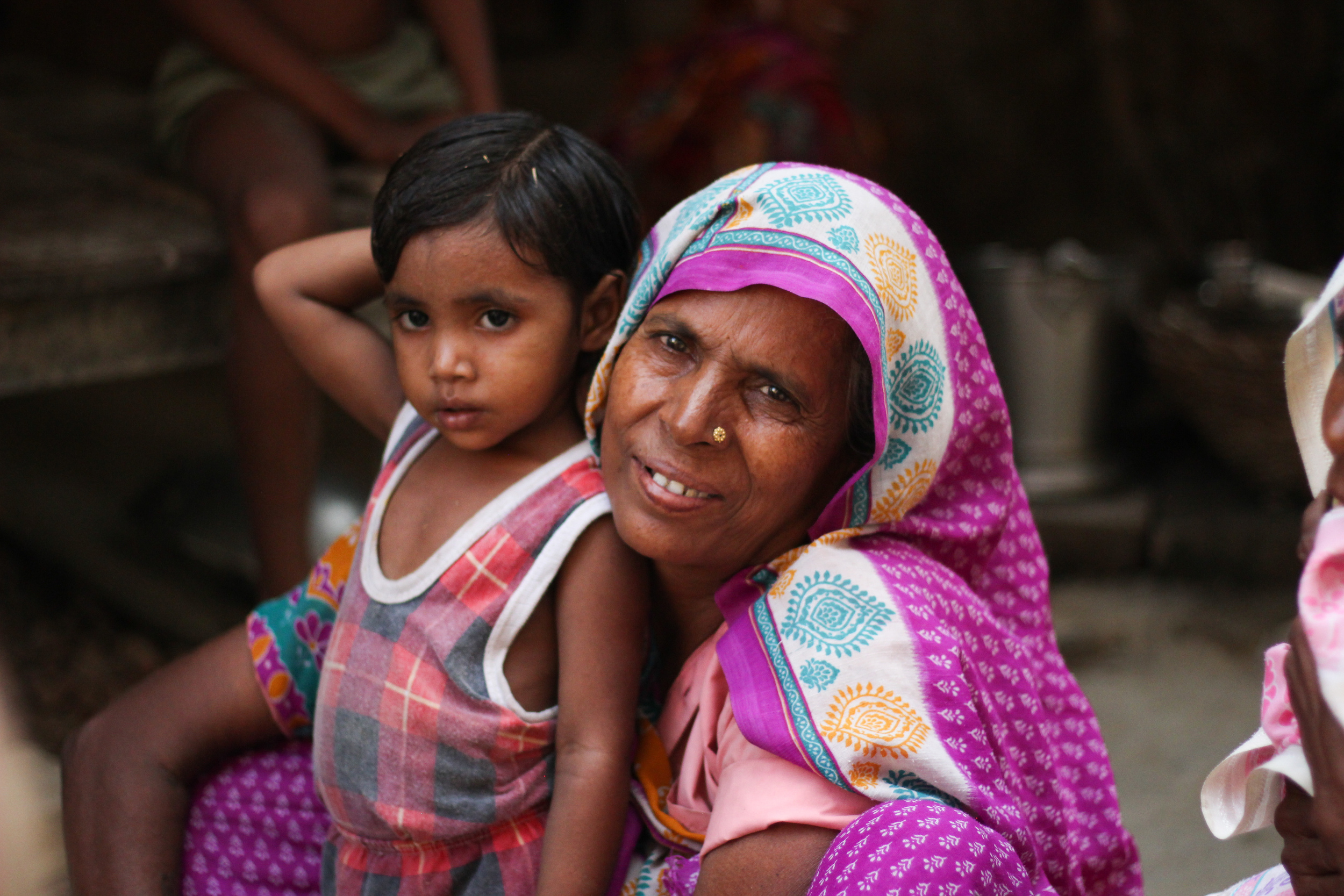 Female children are devalued in rural, Indian culture. While sons are favored and desired, girls receive little to no medical attention, due to the economic burden that comes with trying to marry young women. This woman cradles her granddaughter with pride, despite the stigma associated with being born female.