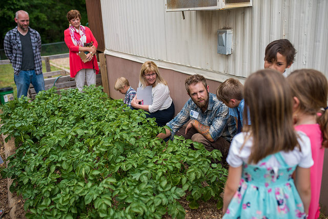 At the Academy for G.O.D. Grandparent Day, grandparents visited the school garden where they got to partake in a garden lesson from Mr. Hartnell, afull-time farmer at G.O.D. Int'l.