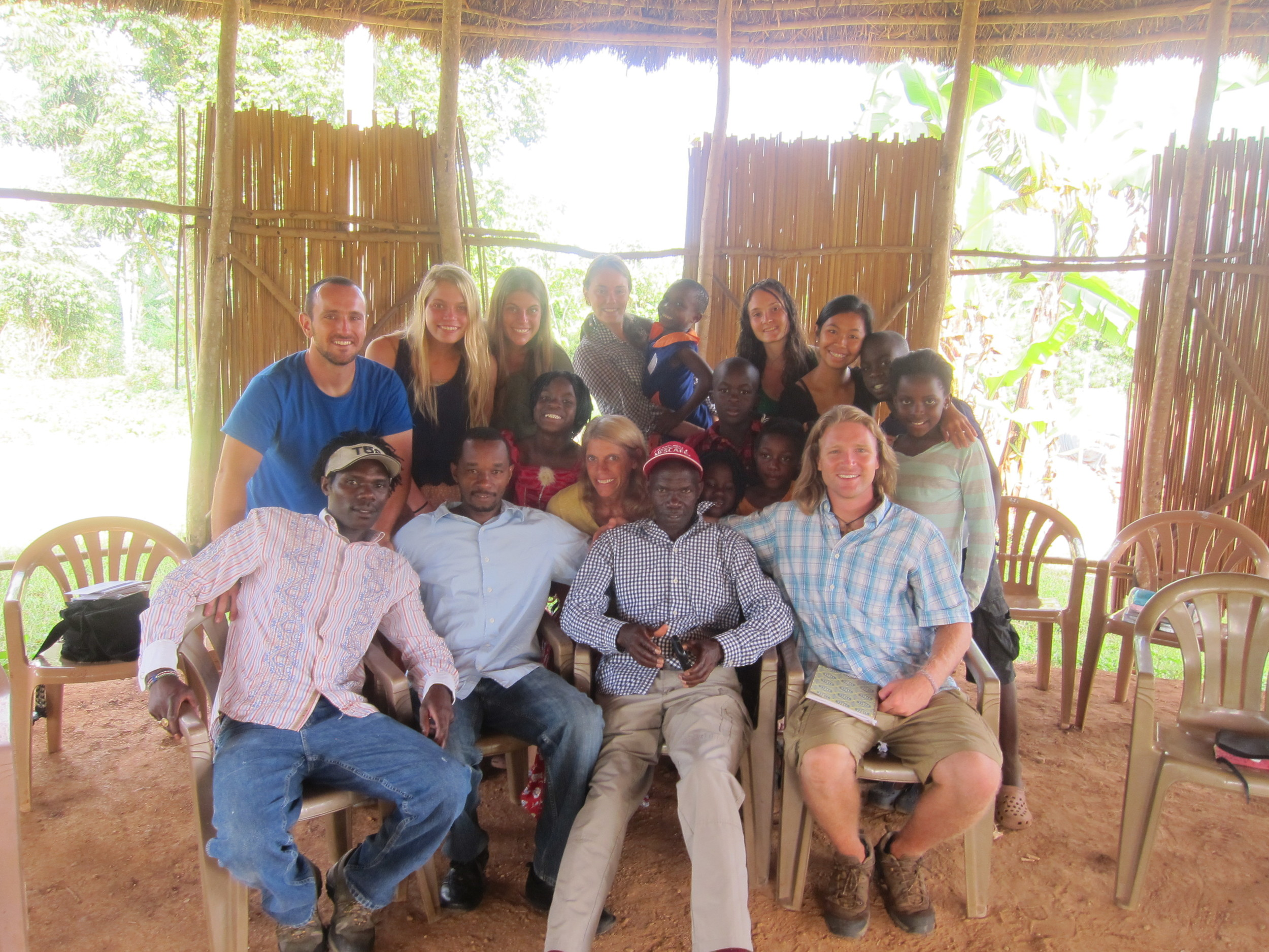 After her first semester of Institute Online, Tammy Byrd (center) was able to travel with us to Uganda, where she witnessed our development plot, met our African cooperatives and ministered to children.