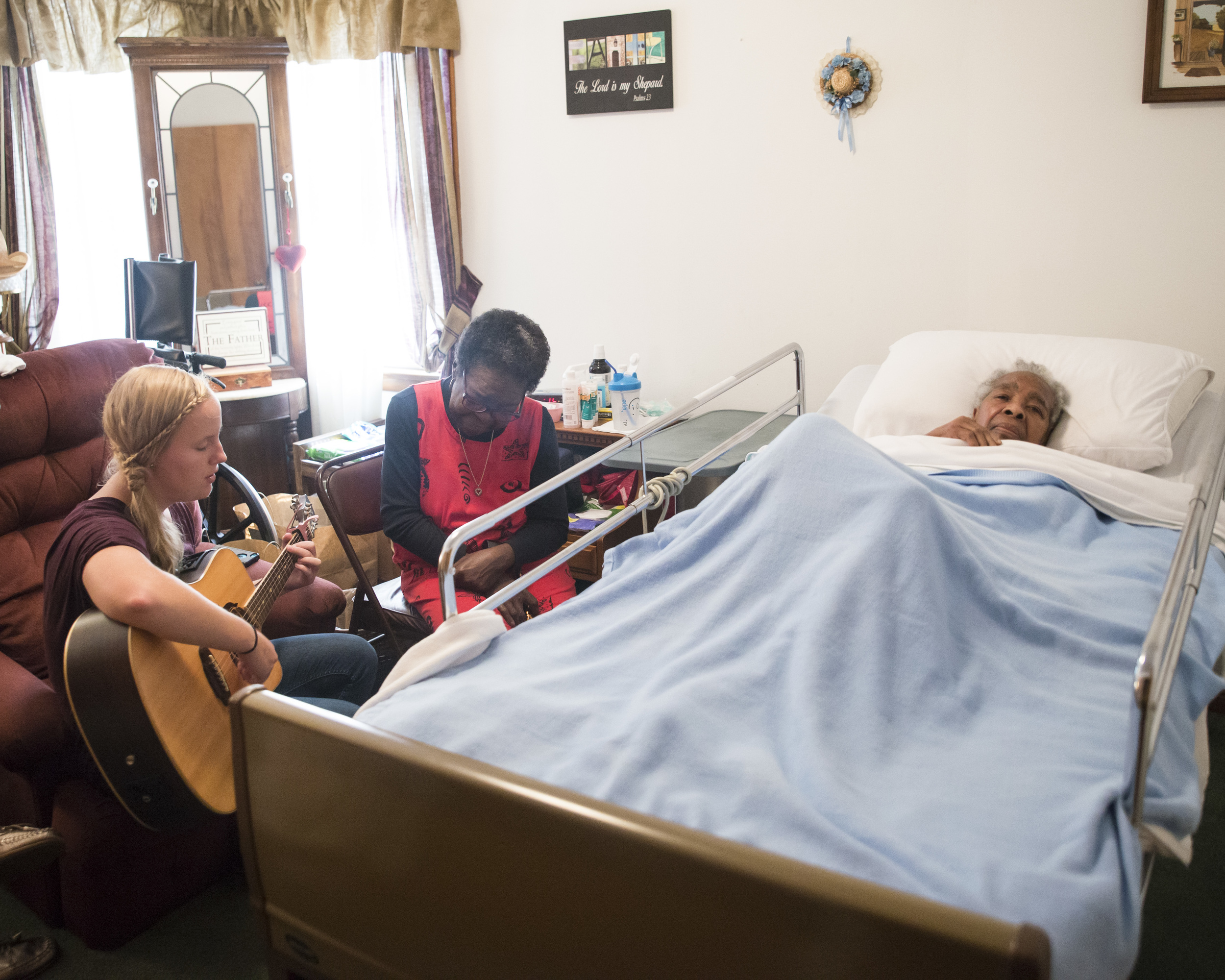 Visiting outside her scheduled volunteer hours, Anna plays her guitar for Mrs. Elizabeth who is comforted by the soft music and the presence of her new friend. All of this is happening in our neighborhood where people are choosing to be neighborly.