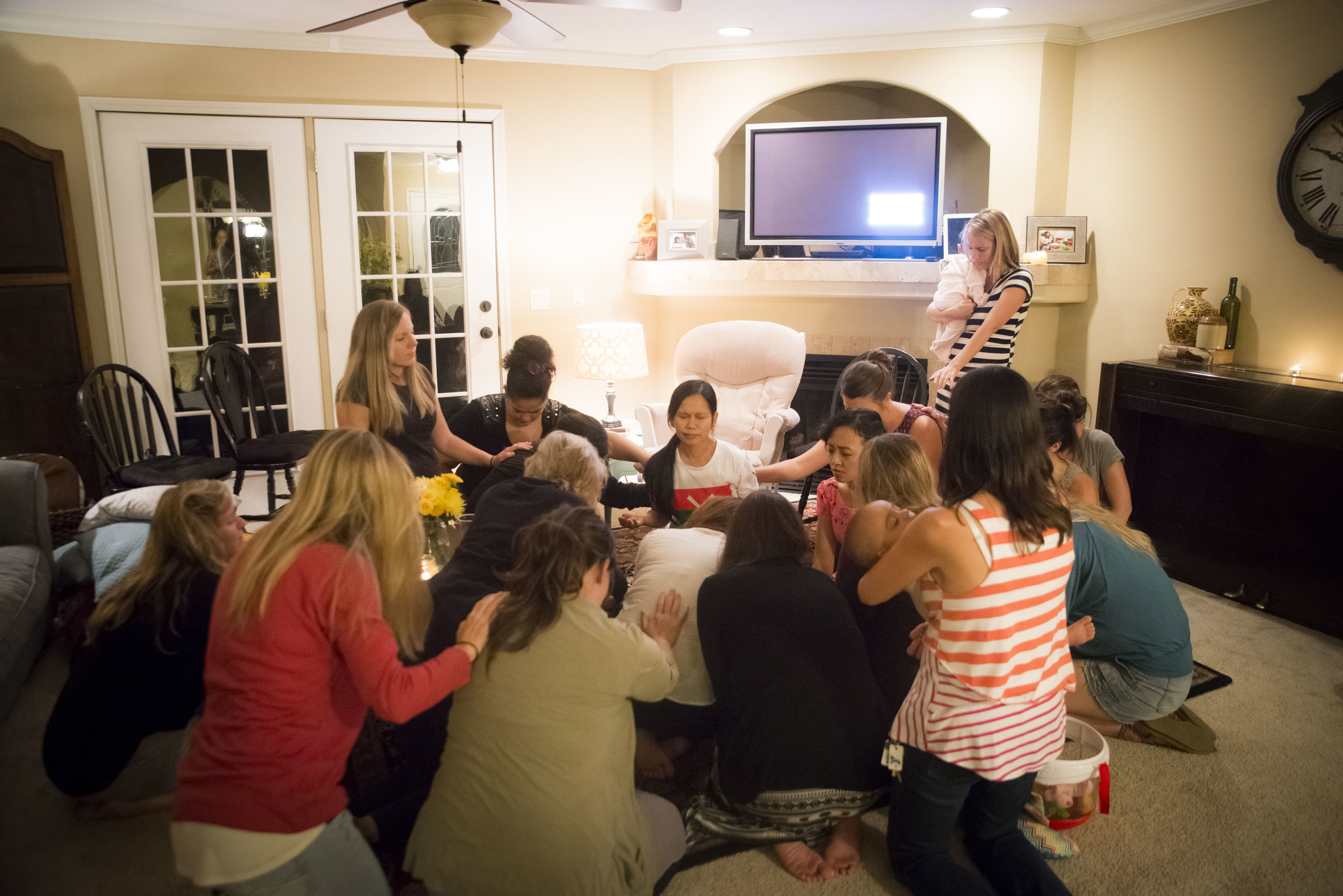 Women gather in prayer after the refugees shared their stories. It was a powerful time for all of the women involved.