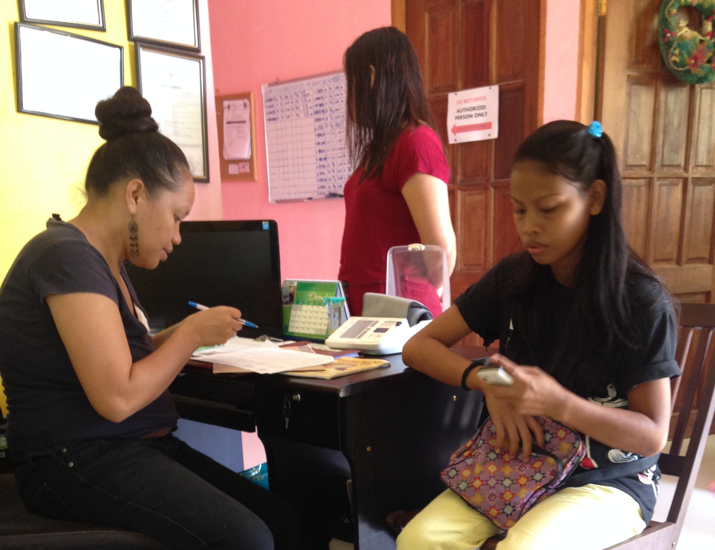 Rina Miller checks in a patient at the local birth center.