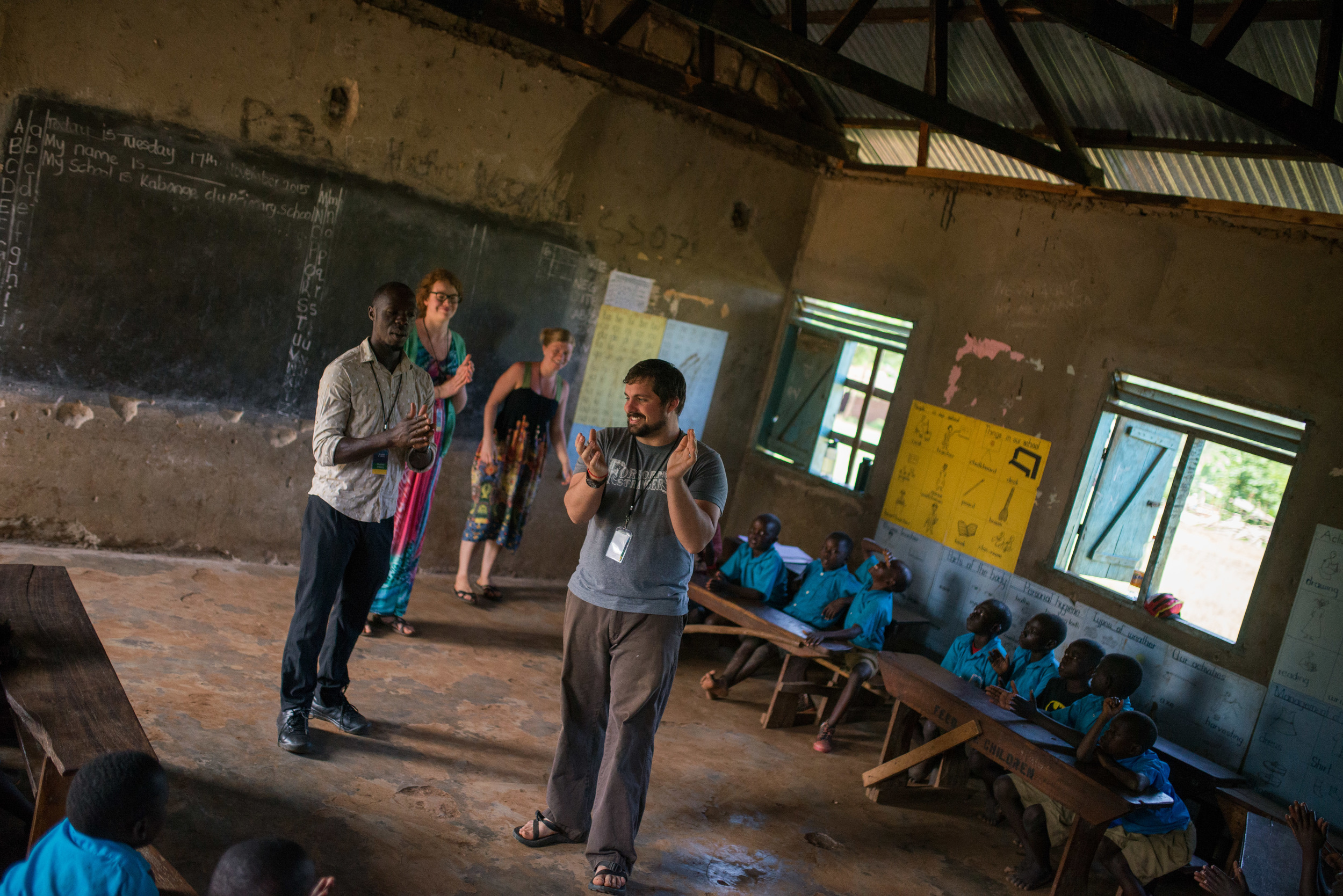 Nick Moore, assisted by Henry, Kara and Christina, teaches a classroom of kids a preventative health lesson. Throughout the week, topics included malaria prevention, hand washing, personal hygiene and more. Here, they are all clapping for a correct answer about malaria.