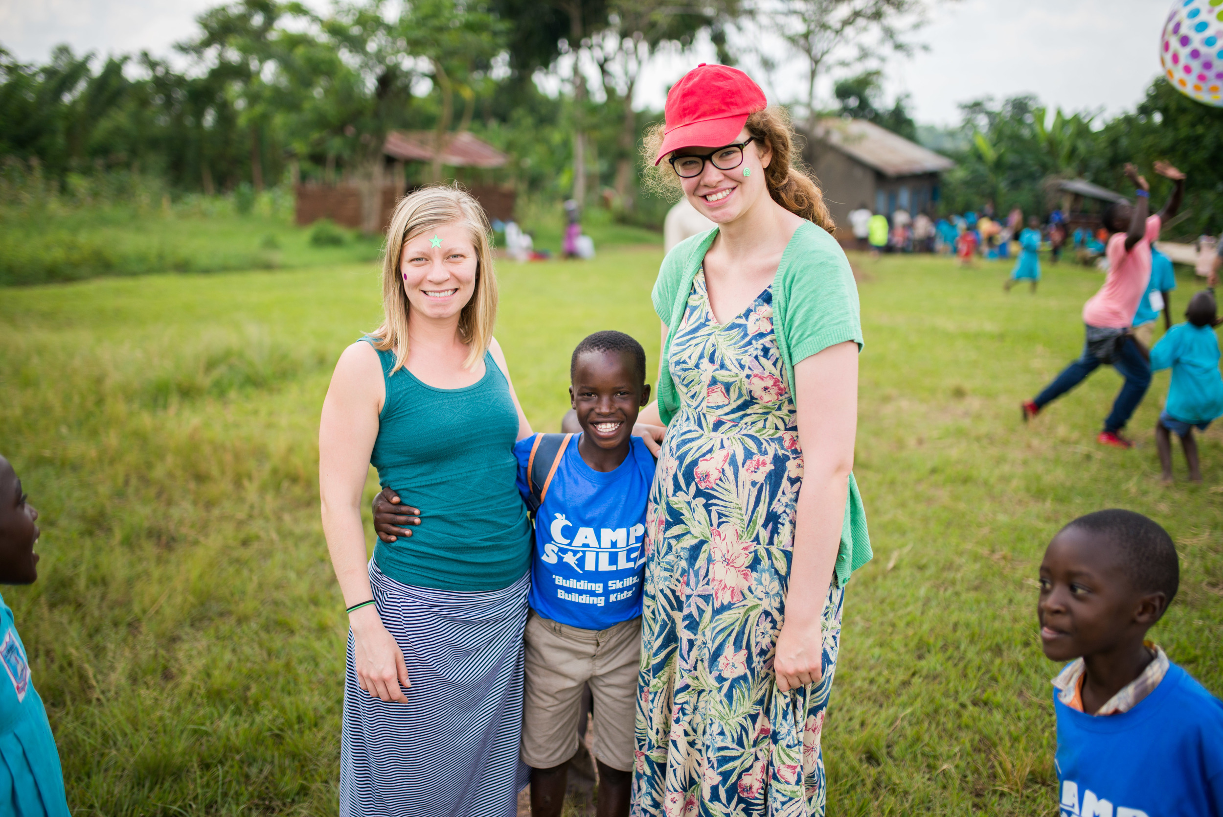 The mark of a successful camp: smiles everywhere! Christina Fowler and Kara Hadley are two immersion trip participants and counselors at the camp.