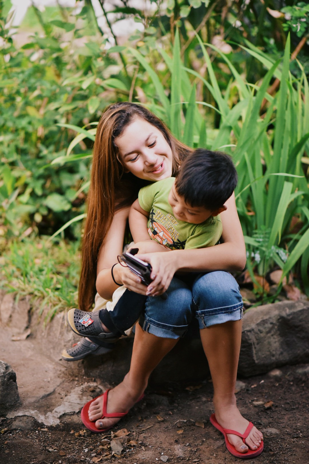Genesis, the big sister of not only 3 younger siblings but a community of children, is a loving and skilled nurturer.
