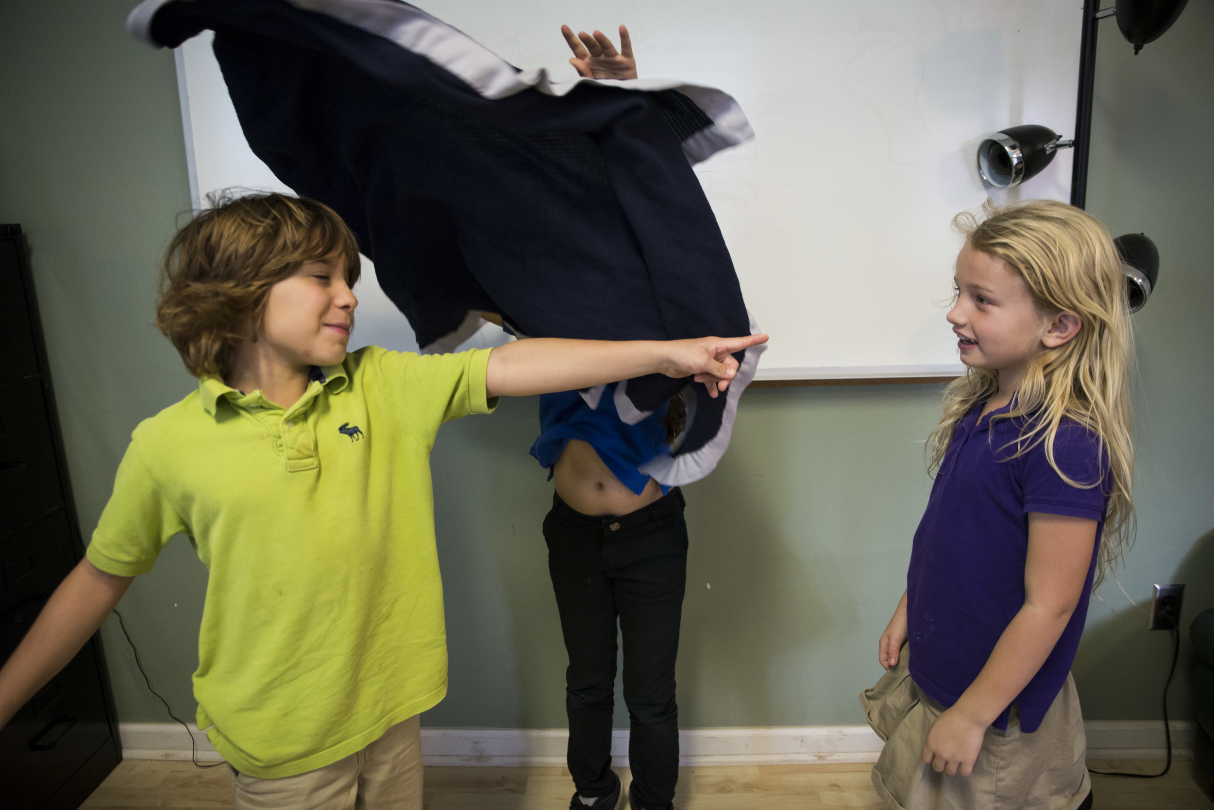 Students play the 'Blanket Statement game', training their ears to listen for exaggerated statements and enthusiastically throwing a blanket over the culprit!