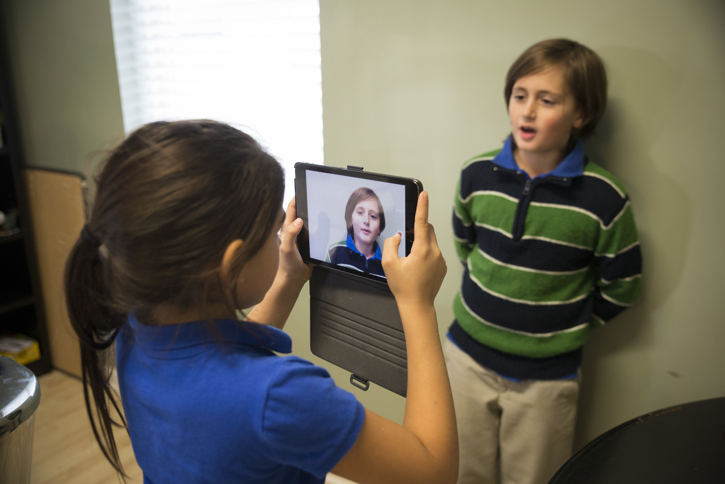 Luci Munoz videos a fellow student as he explains the practice of active listening.