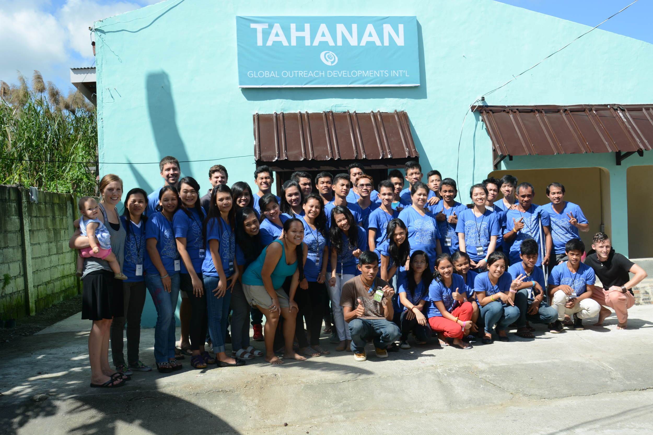 Our 2015 Bible Conference participants in front of our new, renovated Community Center in Tacloban!