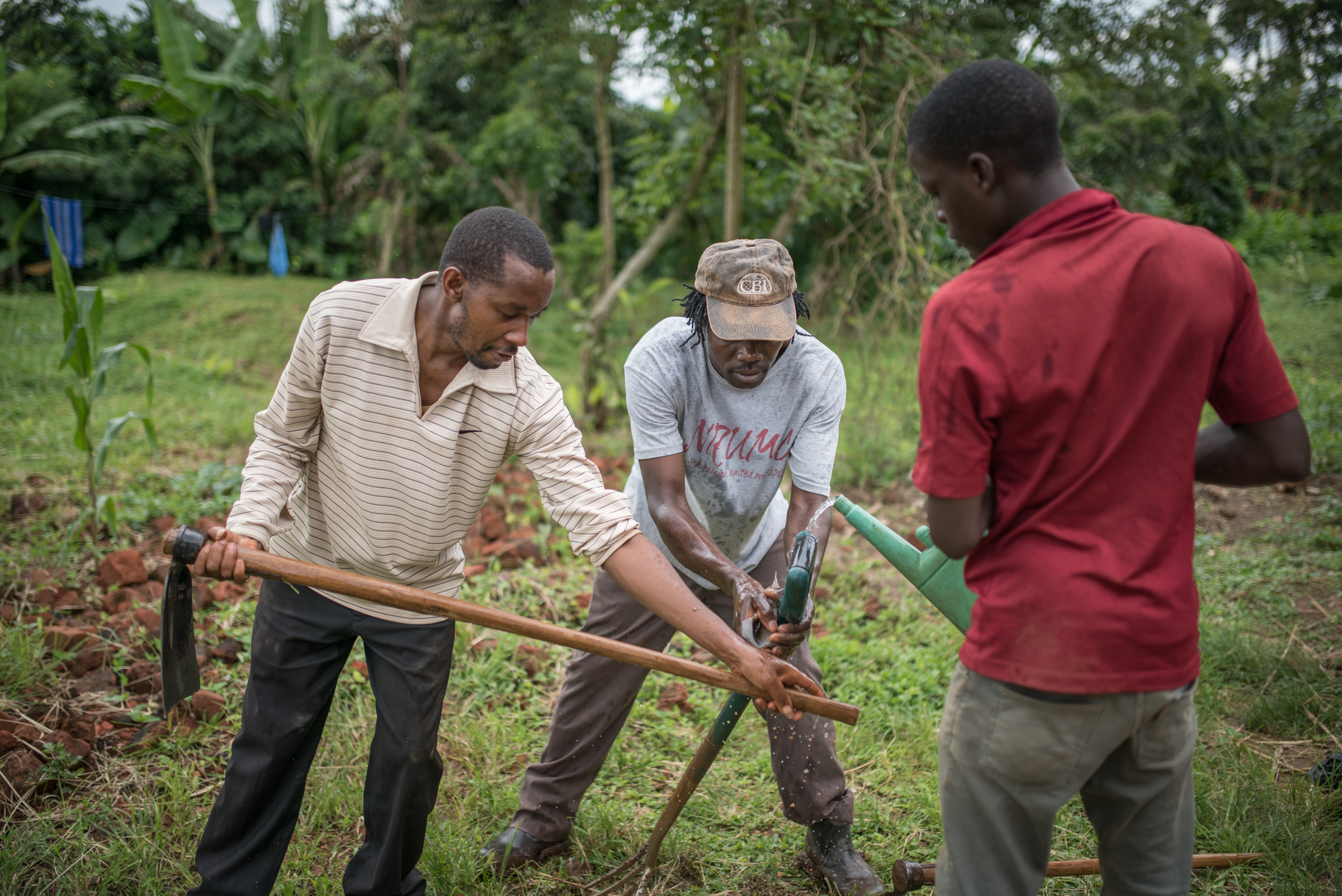 Reuben Ndwiga (center) is our Director of Agriculture in East Africa. After transforming his own land in Kenya, and instructing dozens of neighbors how to do the same, he is now moving to Uganda to head up the food production efforts at our hub. We are so thankful for him!