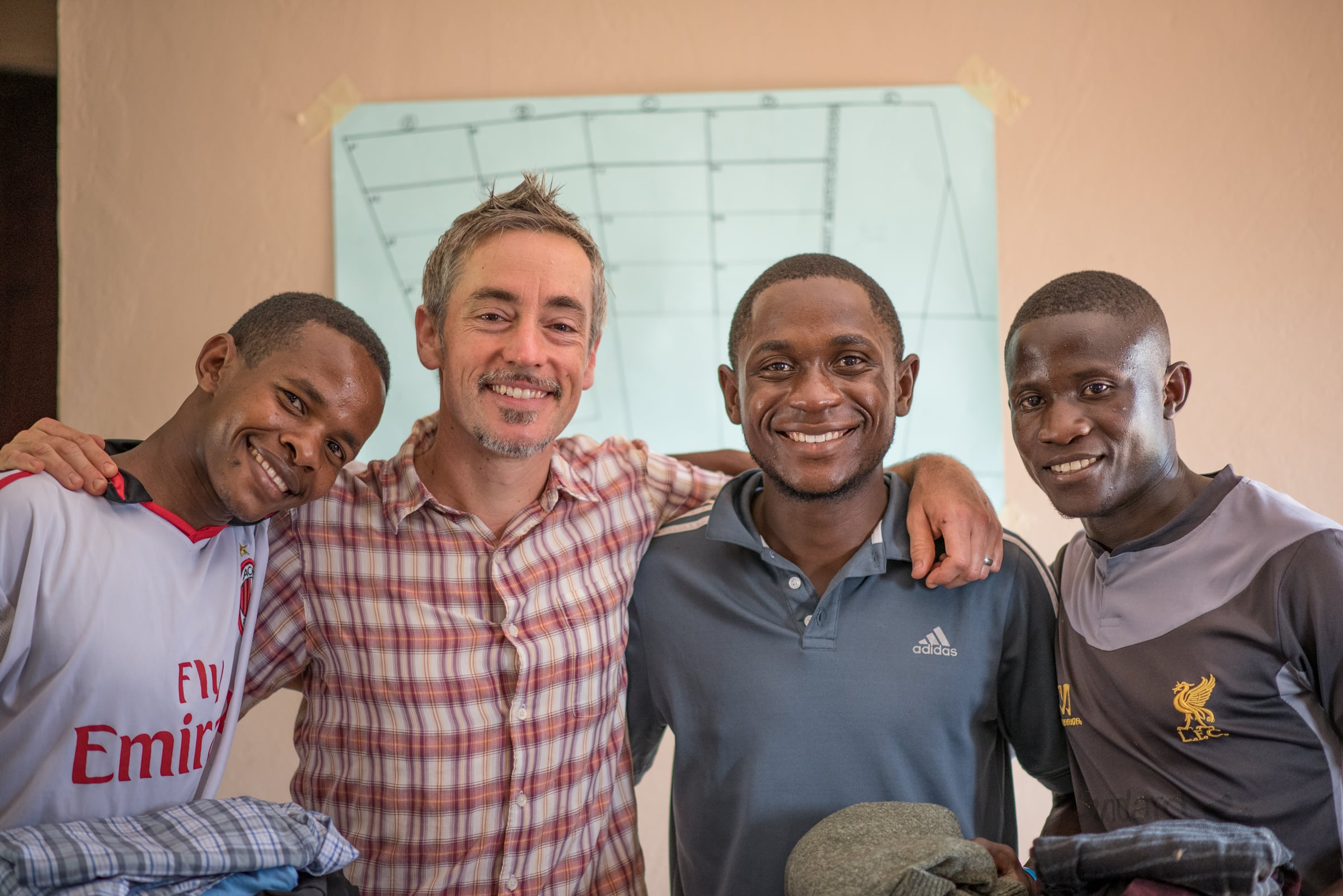 (L-R Simon Peter, Seth Davis, Andrew and Edwin)The bond formed between these men continues to grow. This was right before they set out to Uganda, after receiving several new pairs of work clothes.