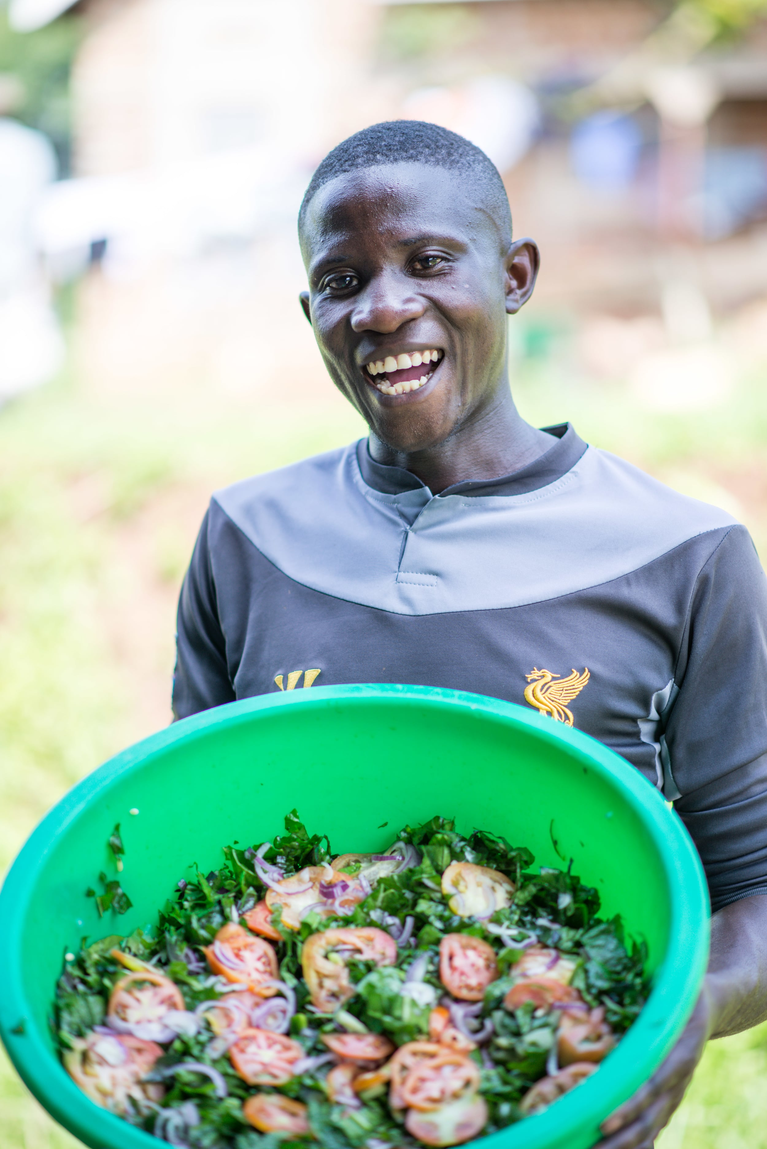 Edwin, a student at the Institute for G.O.D., proudly displays the final product. Delicious!
