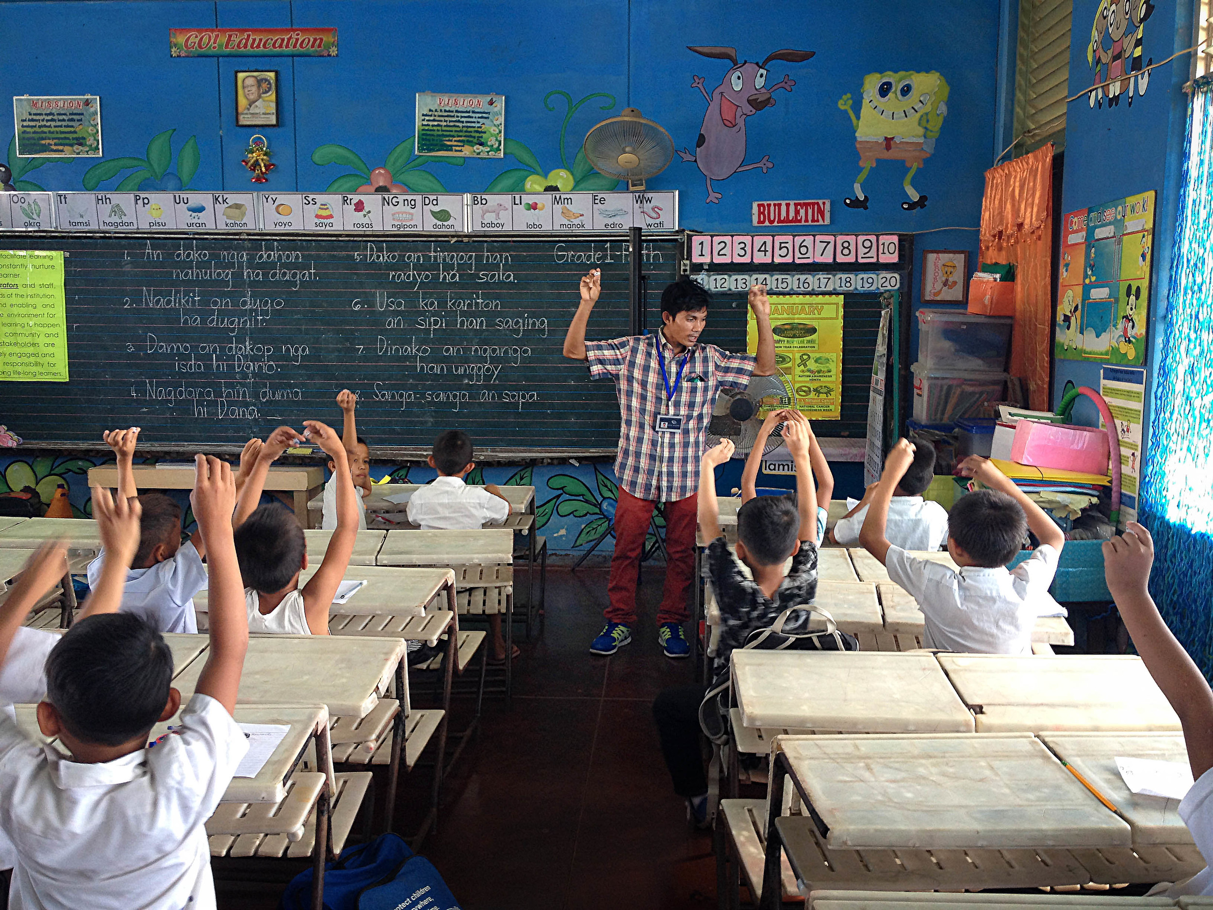 Jovic Roldan, our newest employee in the Philippines, leads a classroom of students in an interactive literacy exercise. The students, despite being in grades 3-5, still struggle with basic letter recognition.