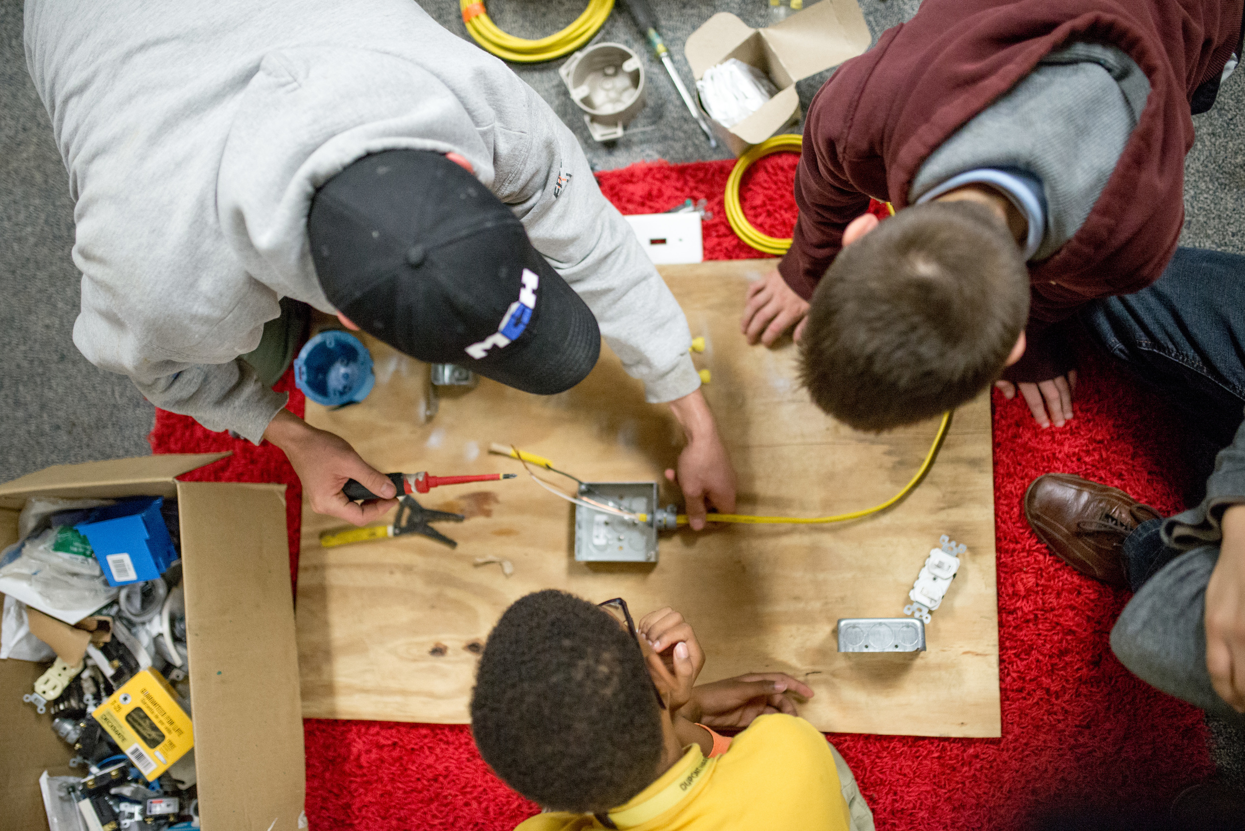 Electrician Tim Sherrod works with students at our after school program to show them the basics of how wiring electricity works--one of the many options kids have to learn practical skills through our programs.