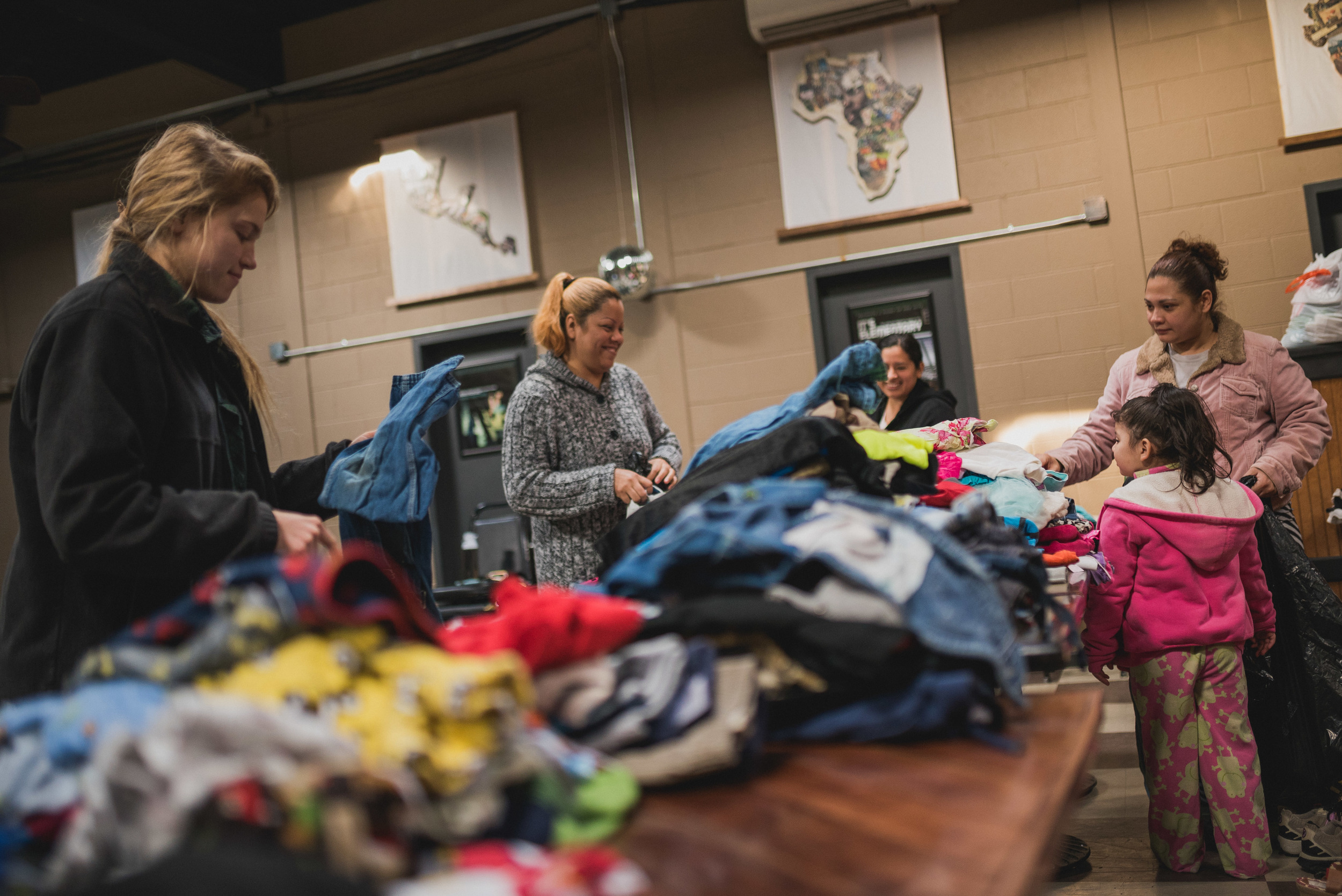 Chapel is followed by community improvement projects, like this one where students organized a free clothing swap for neighbors in need in the cold winter months.