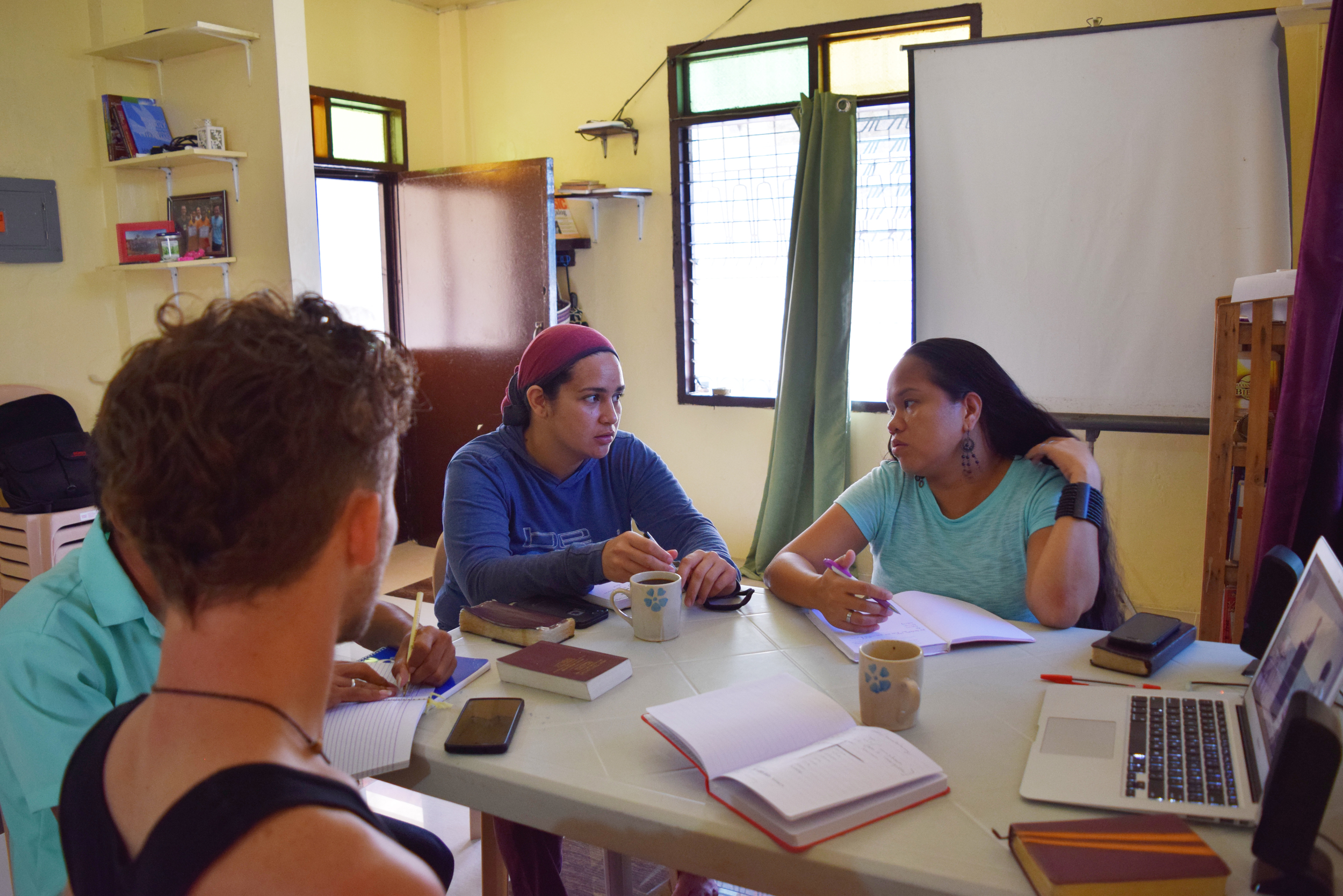 In the Philippines, our development workers Clark and Rina Miller discuss the course content with Leafa Vagatai, who is on a 6-month study abroad.