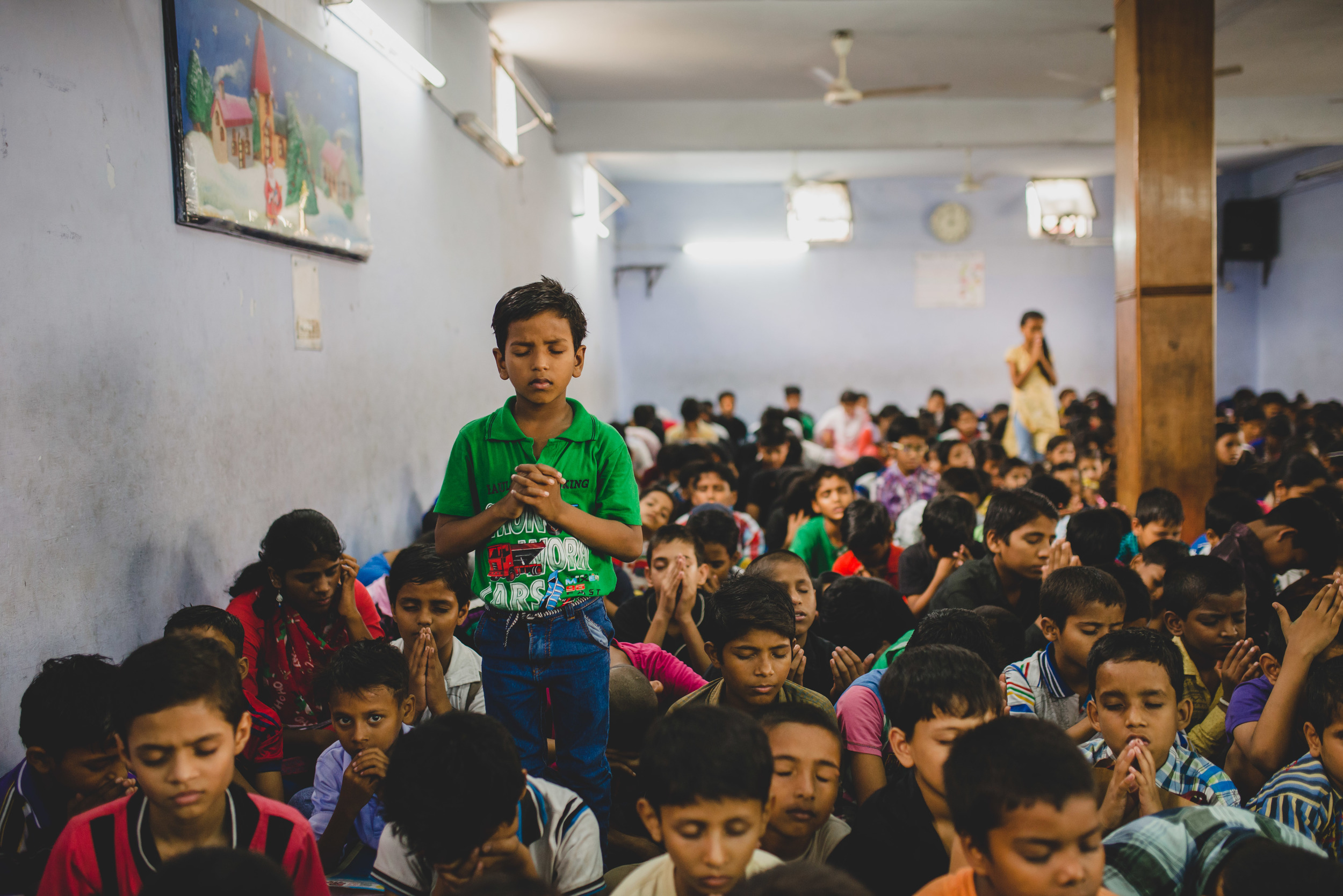 When we volunteered to help at a church's VBS we found 300+ children sitting on the floor in a non-air conditioned room for over 3 hours. There was no personal space, no accommodating seating, no temperature-controlled environment, and no hands-on activities. But those things did not prevent the children from expressing their love for God during a time of worship and prayer. Responding to the worship songs, some children rose to their feet while others fell to their knees. With eyes closed and hand clasped, the children poured out their prayers and praises to God.