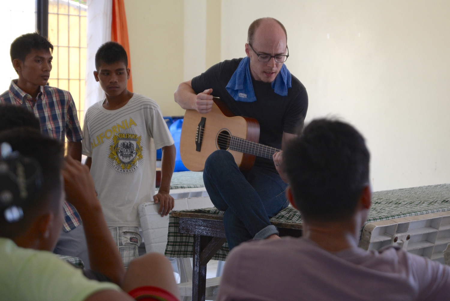 Intern Richard Gowen singing some of his original songs for our songwriting and recording workshop.