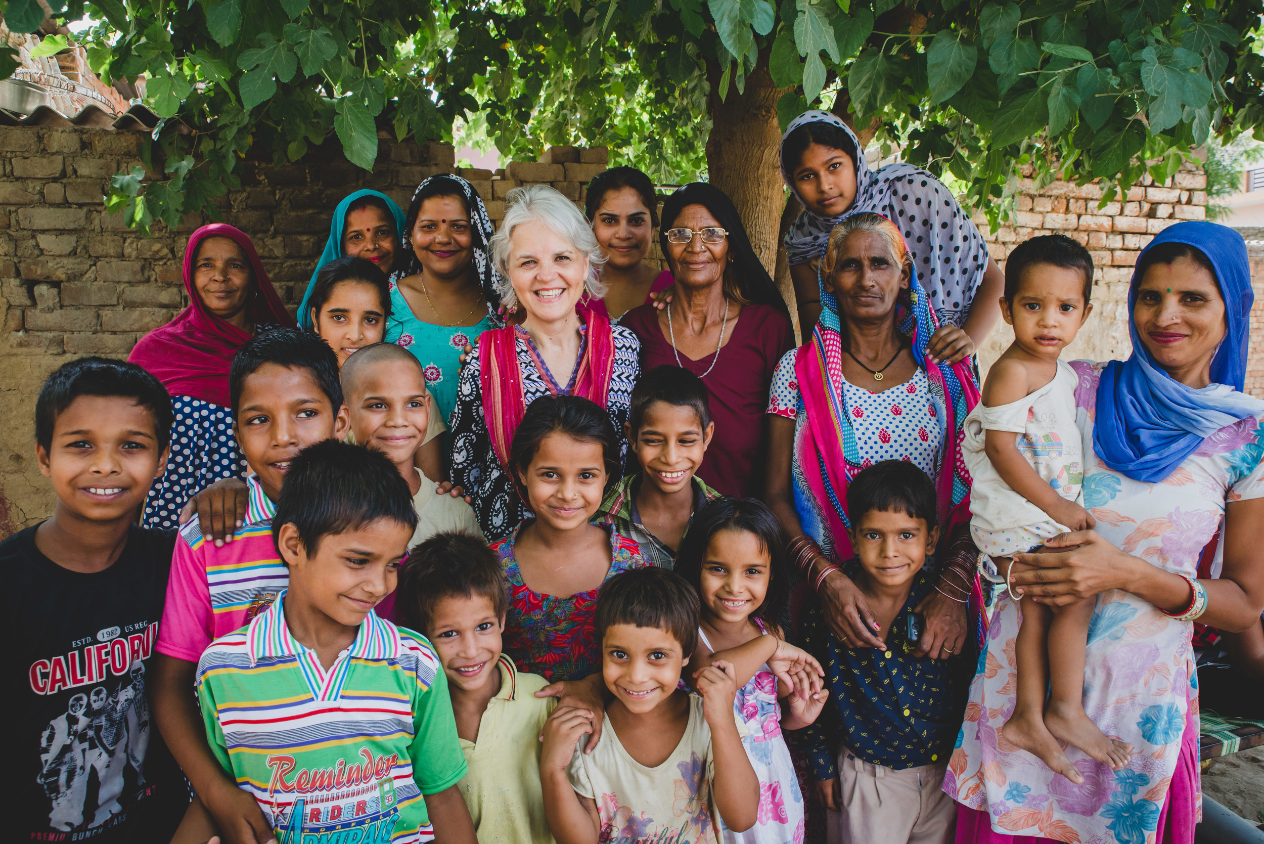 "A mother of five children herself, many of the women Rosemary interviews are surprised to meet an American woman with ""so many"" children. In India, cultural pressure is strong to have ""one or none."""